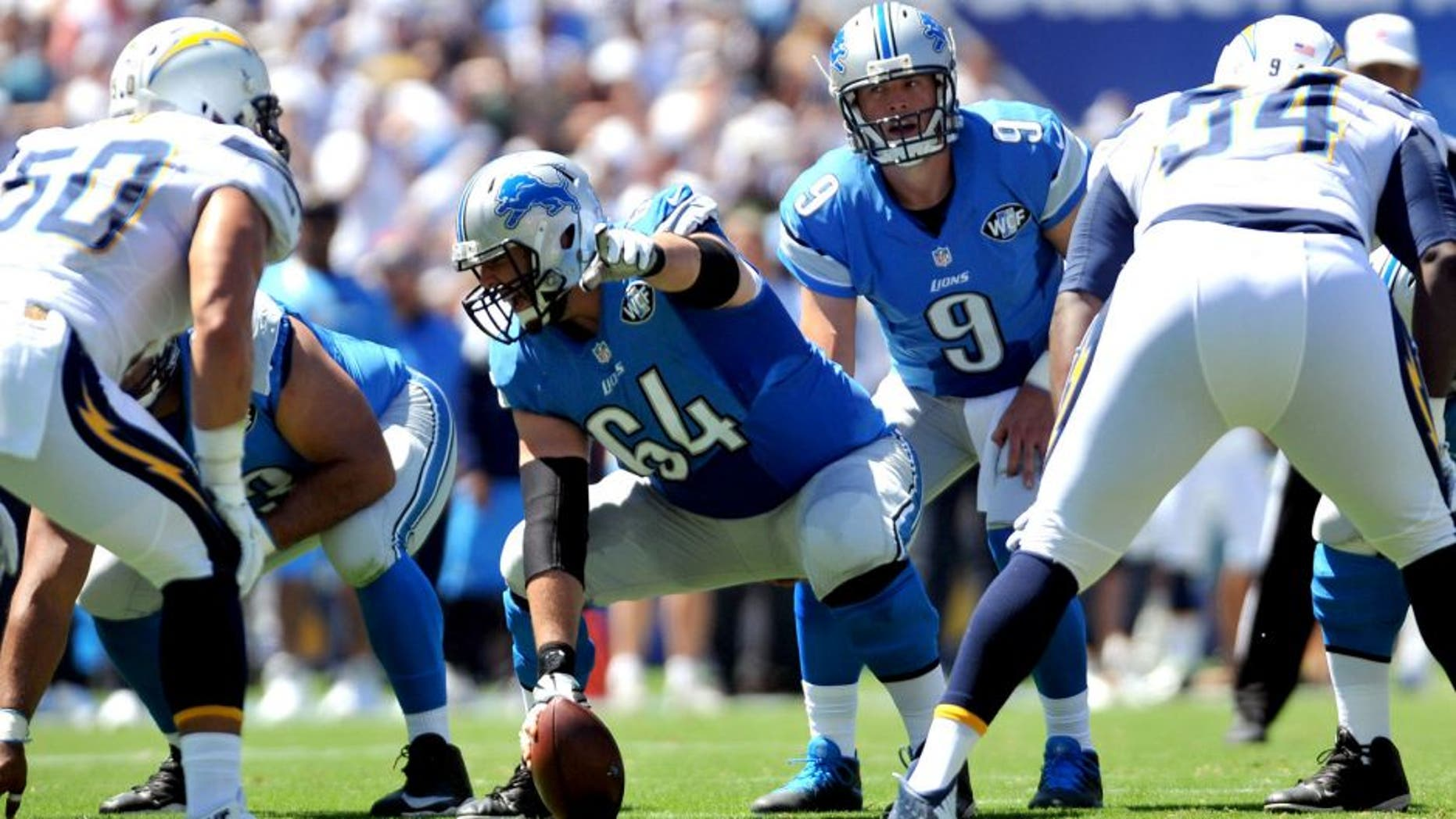 Sep 13, 2015; San Diego, CA, USA; Detroit Lions center Travis Swanson (64) points out a defensive player during the game against the San Diego Chargers at Qualcomm Stadium. San Diego won 33-28. Mandatory Credit: Orlando Ramirez-USA TODAY Sports