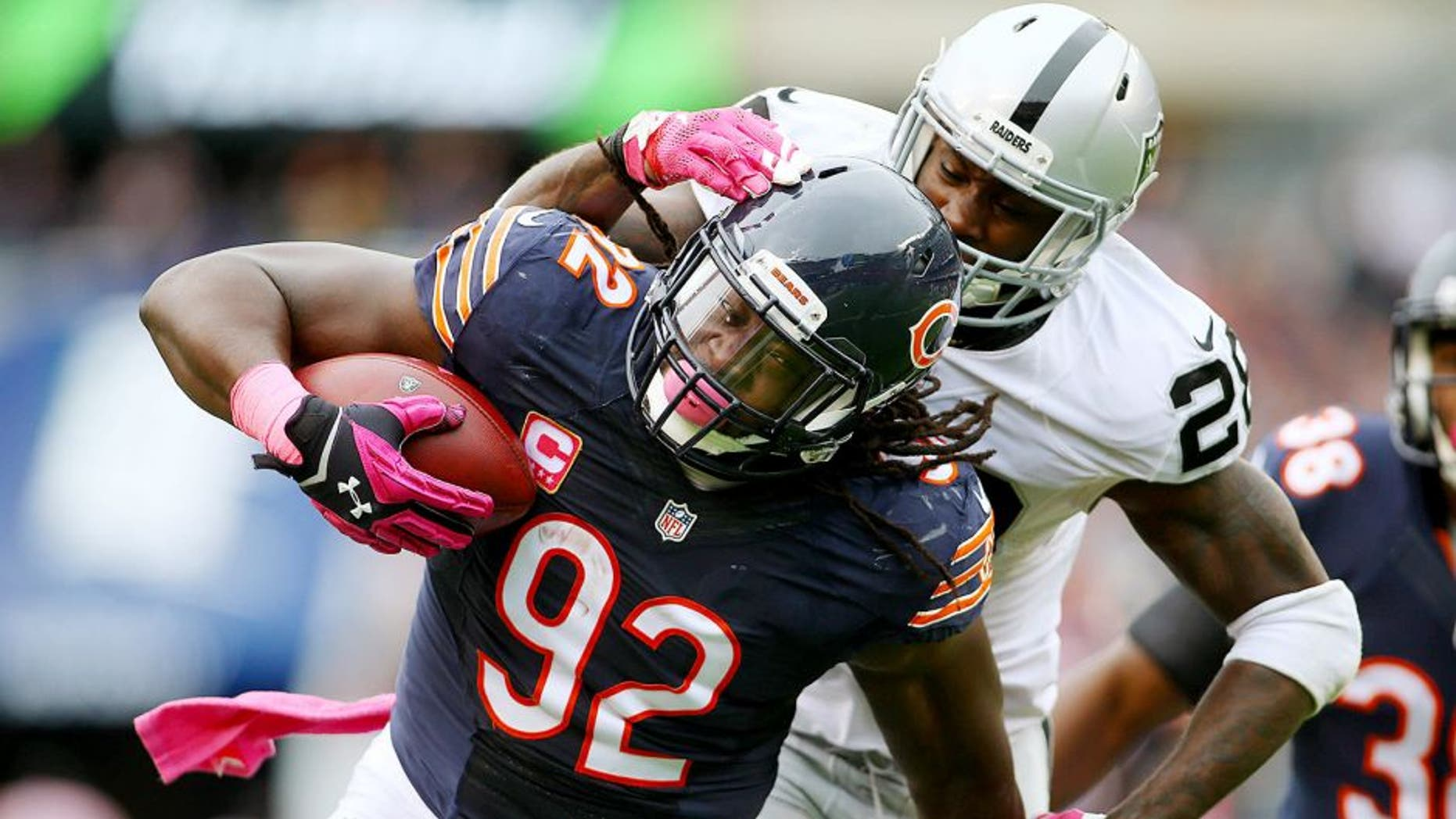 Oct 4, 2015; Chicago, IL, USA; Chicago Bears outside linebacker Pernell McPhee (92) intercepts a pass intended for Oakland Raiders running back Latavius Murray (28) during the second quarter at Soldier Field. Mandatory Credit: Jerry Lai-USA TODAY Sports