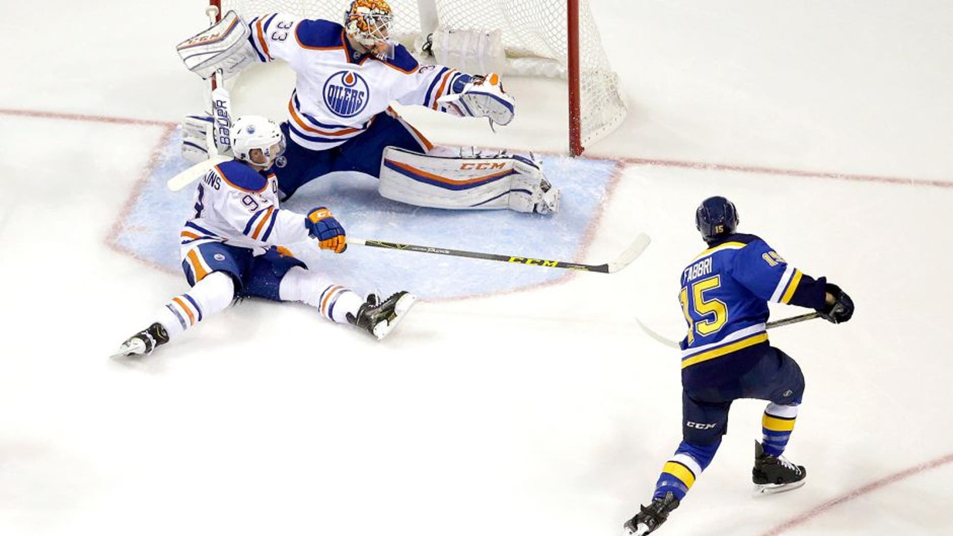 St. Louis Blues' Robby Fabbri, right, scores past Edmonton Oilers goalie Cam Talbot and Ryan Nugent-Hopkins, bottom left, during the third period of an NHL hockey game Thursday, Oct. 8, 2015, in St. Louis. The Blues won 3-1. (AP Photo/Jeff Roberson)