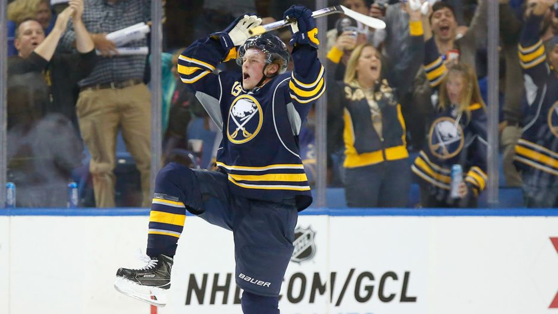 Oct 8, 2015; Buffalo, NY, USA; Buffalo Sabres center Jack Eichel (15) celebrates after scoring his first NHL goal during the third period against the Ottawa Senators at First Niagara Center. Senators beat the Sabres 3-1. Mandatory Credit: Kevin Hoffman-USA TODAY Sports