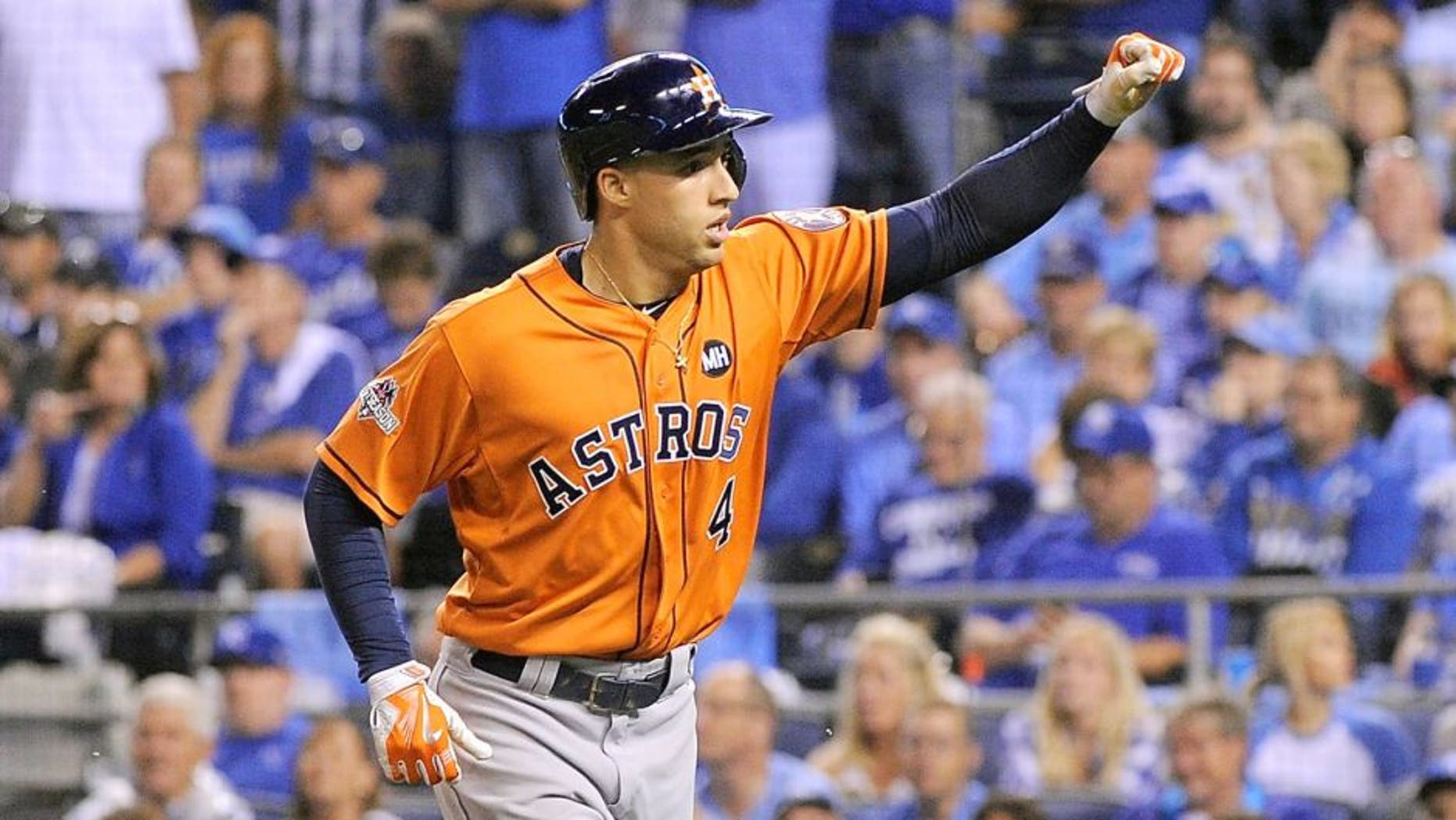 George Springer #4 of the Houston Astros celebrates after hitting a solo home run in the fifth inning against the Kansas City Royals during game one of the American League Division Series at Kauffman Stadium on October 8, 2015 in Kansas City, Missouri. (Photo by Ed Zurga/Getty Images)