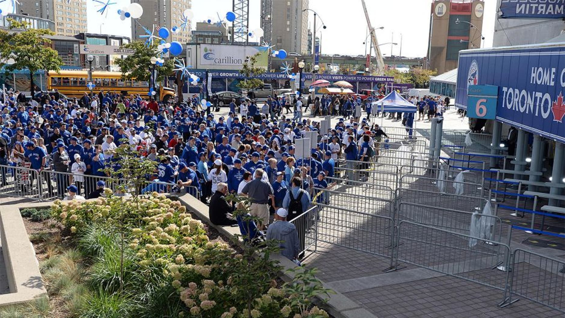 Oct 8, 2015; Toronto, Ontario, CAN; Fans of the Toronto Blue Jays line up outside the Rogers Centre prior to game one of the ALDS against the Texas Rangers. Mandatory Credit: Nick Turchiaro-USA TODAY Sports