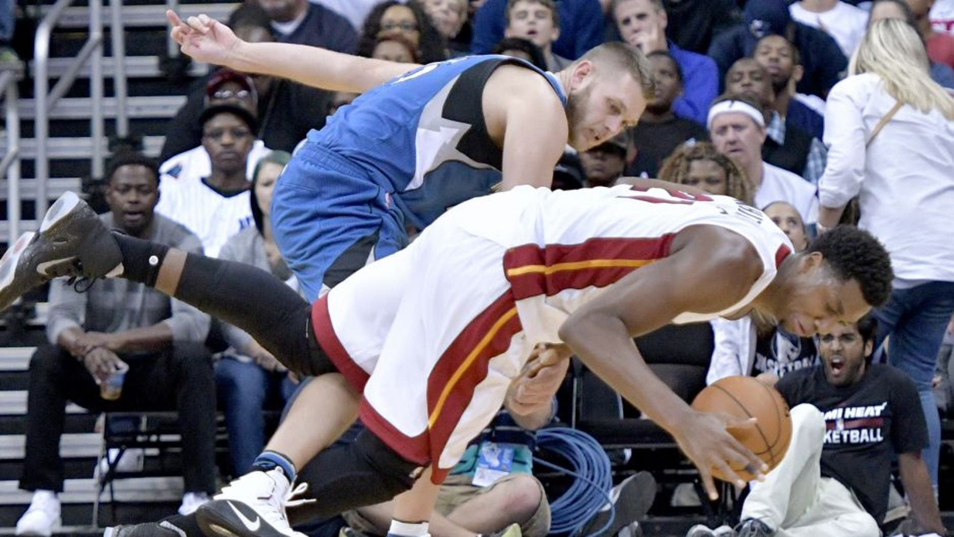 Oct 8, 2016; Kansas City , MO, USA; Miami Heat center Hassan Whiteside (21) and Minnesota Timberwolves center Cole Aldrich (45) fight for the ball during the second half at Sprint Center. Minnesota won 109 - 100. Mandatory Credit: Denny Medley-USA TODAY Sports