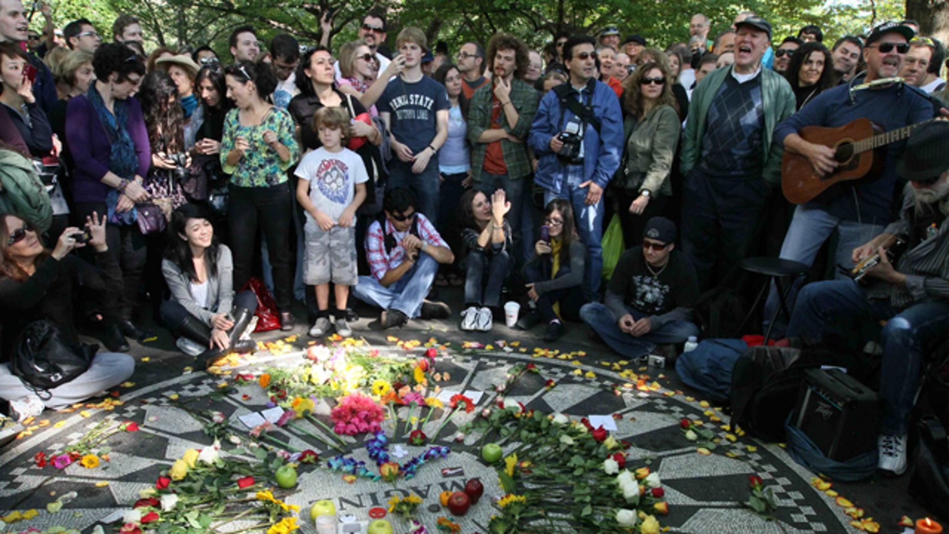 Oct. 9: People sing as they gather around the Imagine mosaic in Strawberry Fields in New York's Central Park, the day that would have been John Lennon's 70th birthday.