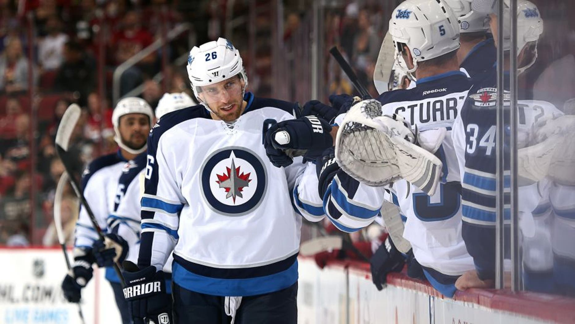 GLENDALE, AZ - OCTOBER 09: Blake Wheeler #26 of the Winnipeg Jets celebrates with teammates on the bench after scoring a first period goal against the Arizona Coyotes during the NHL game at Gila River Arena on October 9, 2014 in Glendale, Arizona. (Photo by Christian Petersen/Getty Images)