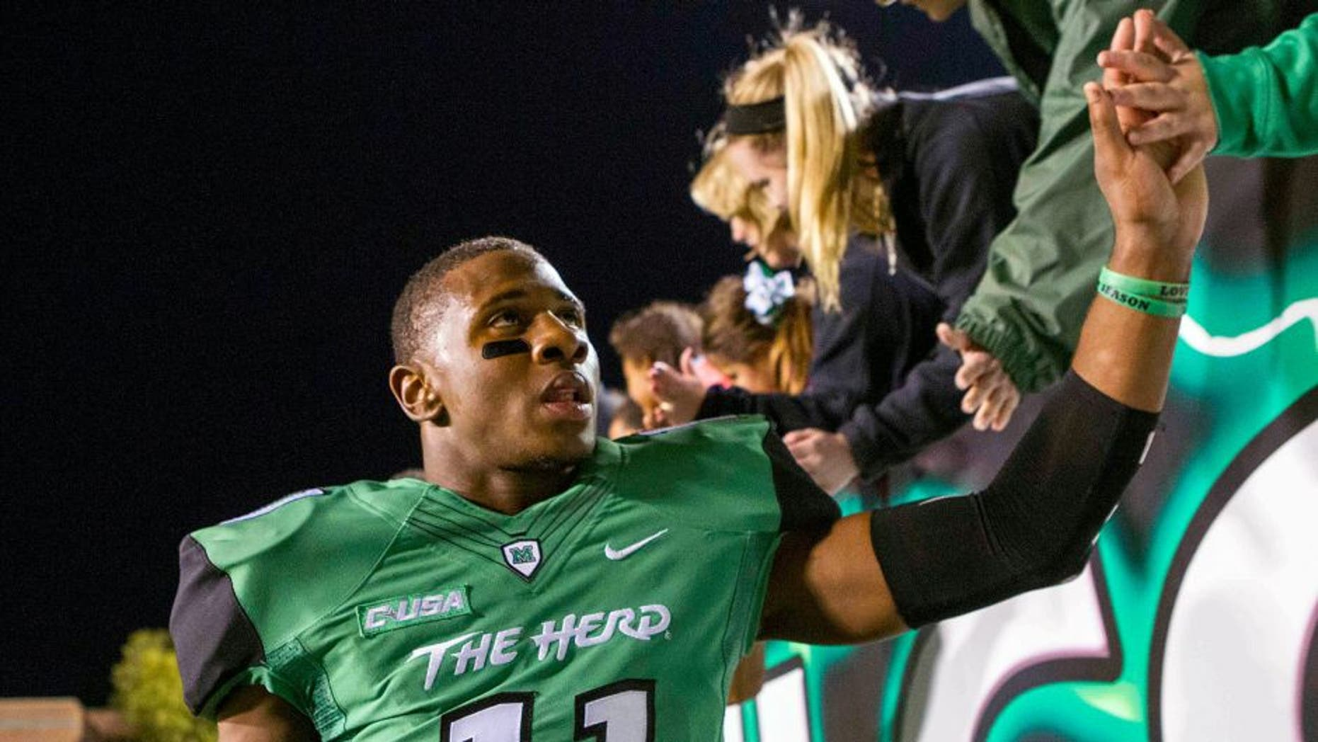 Oct 9, 2015; Huntington, WV, USA; Marshall Thundering Herd defensive back Rodney Allen (11) celebrates beating Southern Miss Golden Eagles at the end of the game at Joan C. Edwards Stadium. Marshall won the game 31-10. Mandatory Credit: Ben Queen-USA TODAY Sports