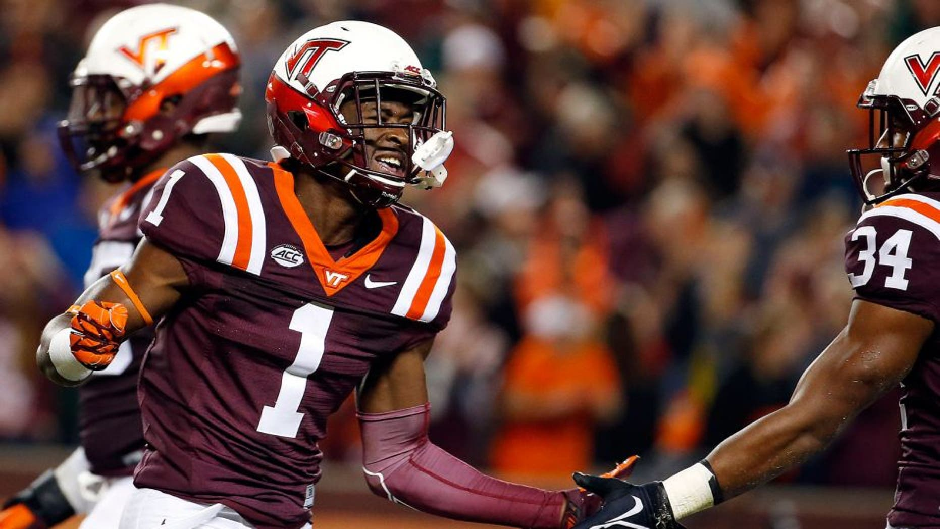 Oct 9, 2015; Blacksburg, VA, USA; Virginia Tech Hokies wide receiver Isaiah Ford (1) celebrates after scoring a touchdown against the North Carolina State Wolfpack at Lane Stadium. Mandatory Credit: Peter Casey-USA TODAY Sports