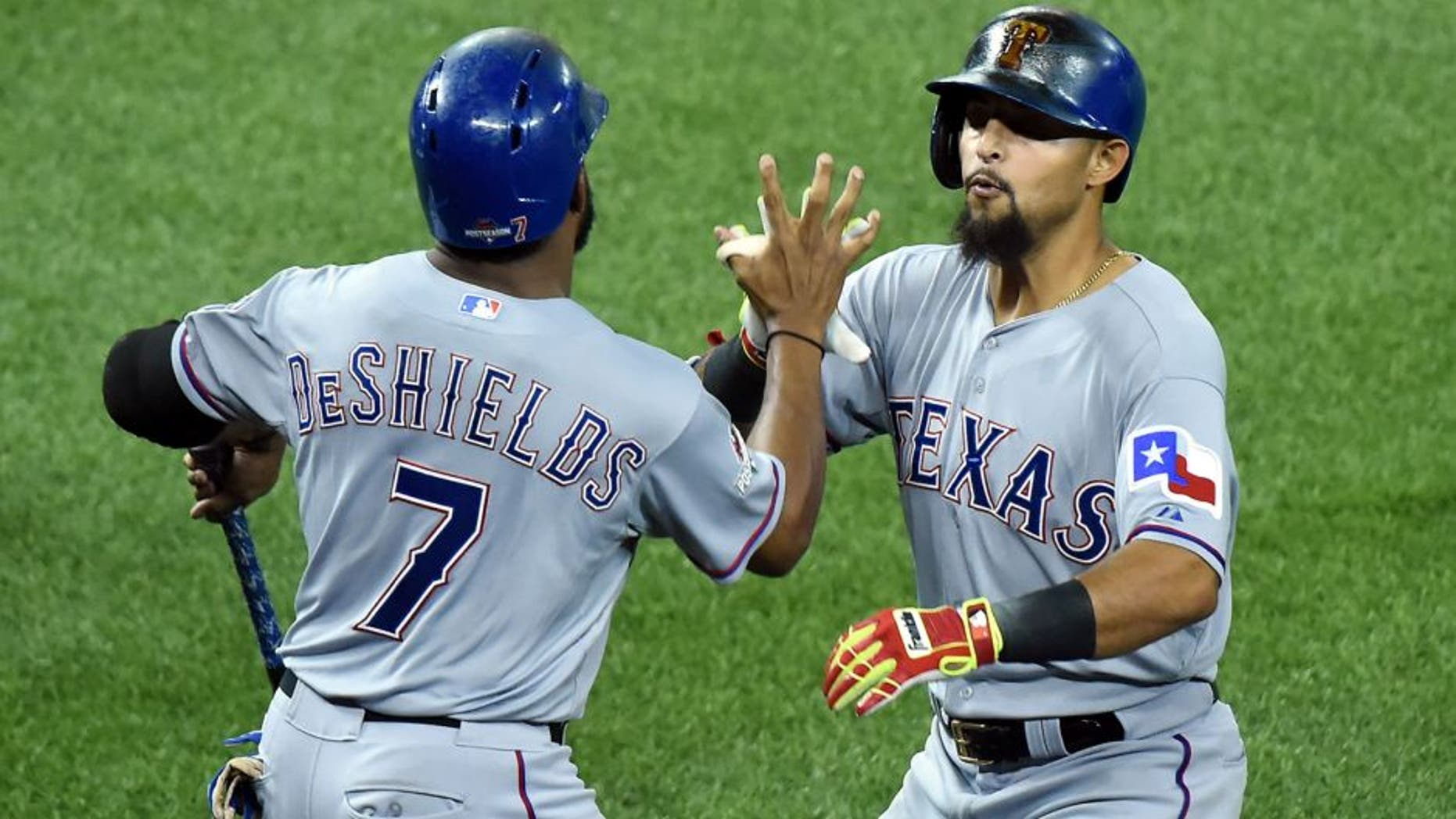 Oct 8, 2015; Toronto, Ontario, CAN; Texas Rangers second baseman Rougned Odor (right) celebrates with center fielder Delino DeShields (7) after hitting a solo home run against the Toronto Blue Jays in the 7th inning in game one of the ALDS at Rogers Centre. Mandatory Credit: Dan Hamilton-USA TODAY Sports