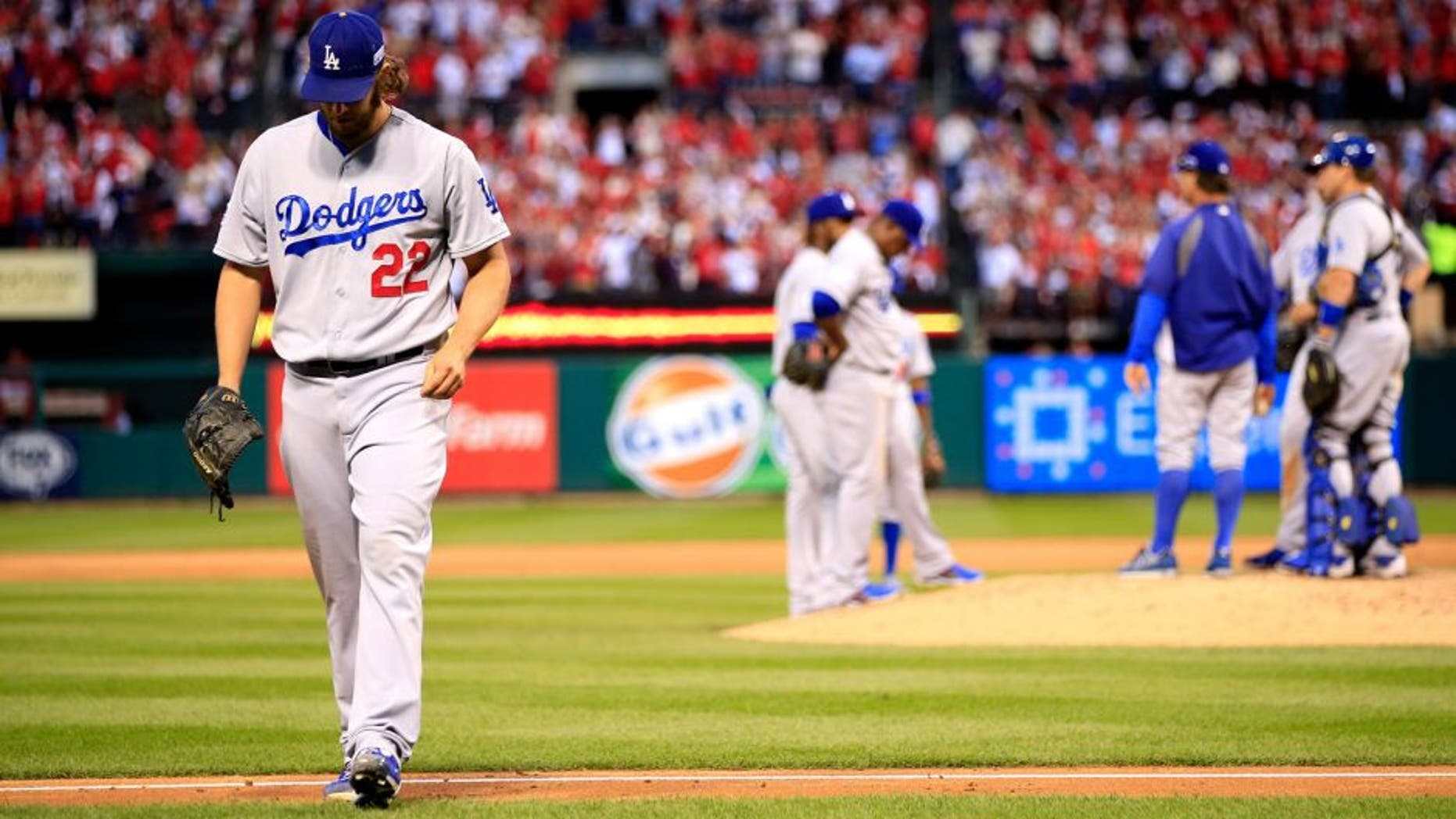 ST LOUIS, MO - OCTOBER 07: Clayton Kershaw #22 of the Los Angeles Dodgers exits the game in the seventh inning after giving up a three run home run against the St. Louis Cardinals in Game Four of the National League Divison Series at Busch Stadium on October 7, 2014 in St Louis, Missouri. (Photo by Jamie Squire/Getty Images)
