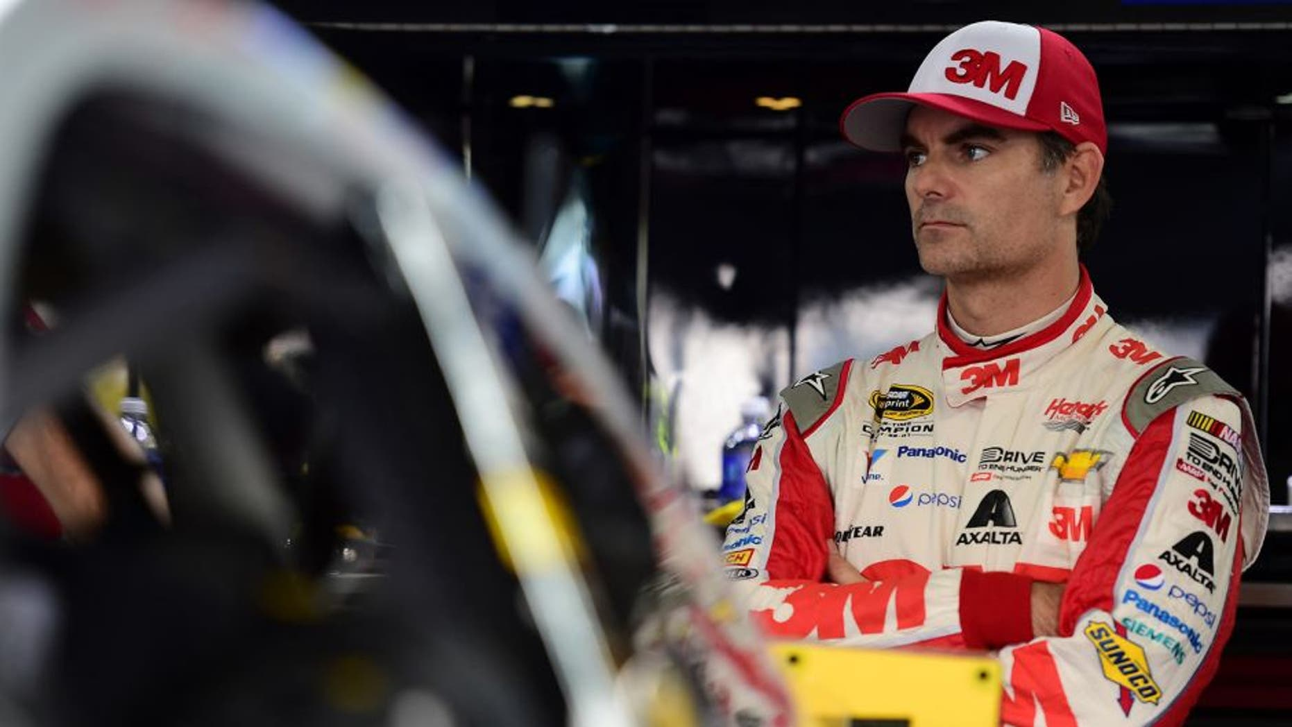 CHARLOTTE, NC - OCTOBER 09: Jeff Gordon, driver of the #24 3M Chevrolet, stands in the garage arstands in the garage areaduring practice for the NASCAR Sprint Cup Series Bank of America 500 at Charlotte Motor Speedway on October 9, 2015 in Charlotte, North Carolina. (Photo by Jared C. Tilton/NASCAR via Getty Images)
