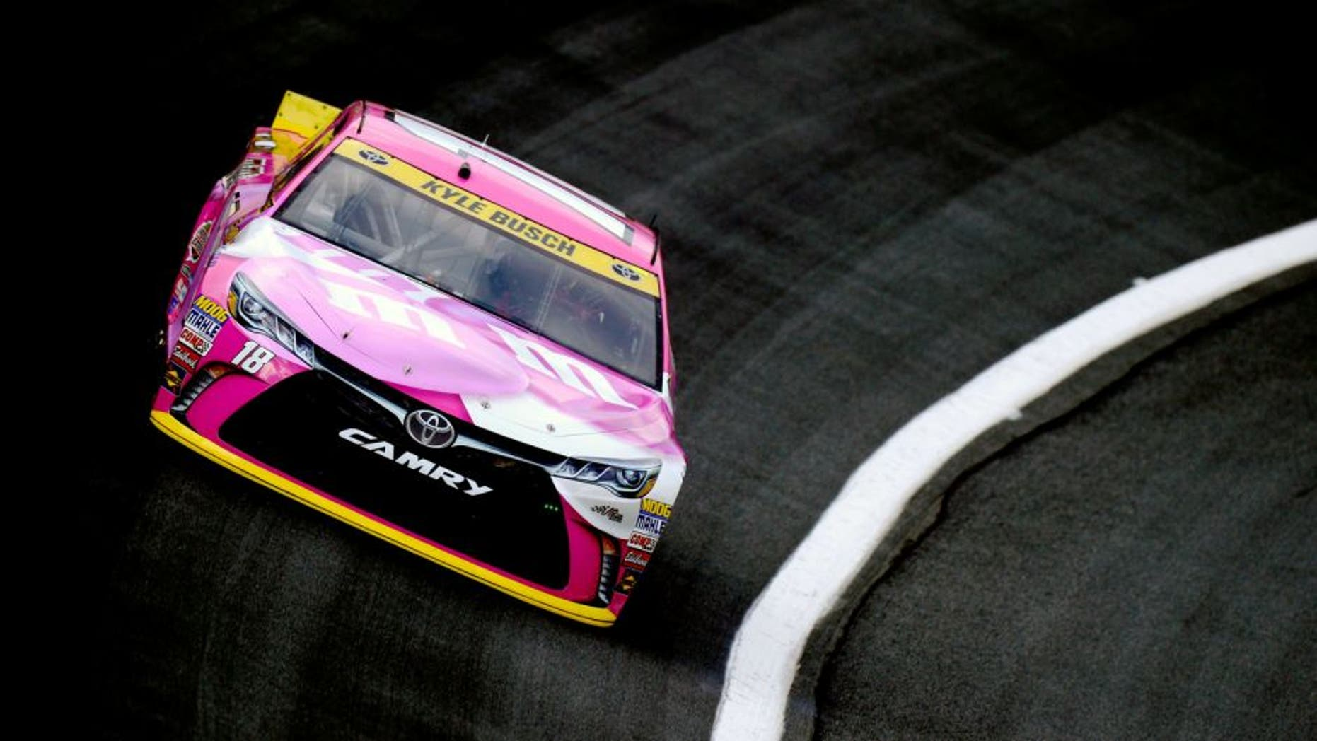 CHARLOTTE, NC - OCTOBER 08: Kyle Busch, driver of the #18 M&M's Pretty In Pink Foundation Toyota, during practice for the NASCAR Sprint Cup Series Bank of America 500 at Charlotte Motor Speedway on October 8, 2015 in Charlotte, North Carolina. (Photo by Robert Laberge/Getty Images)