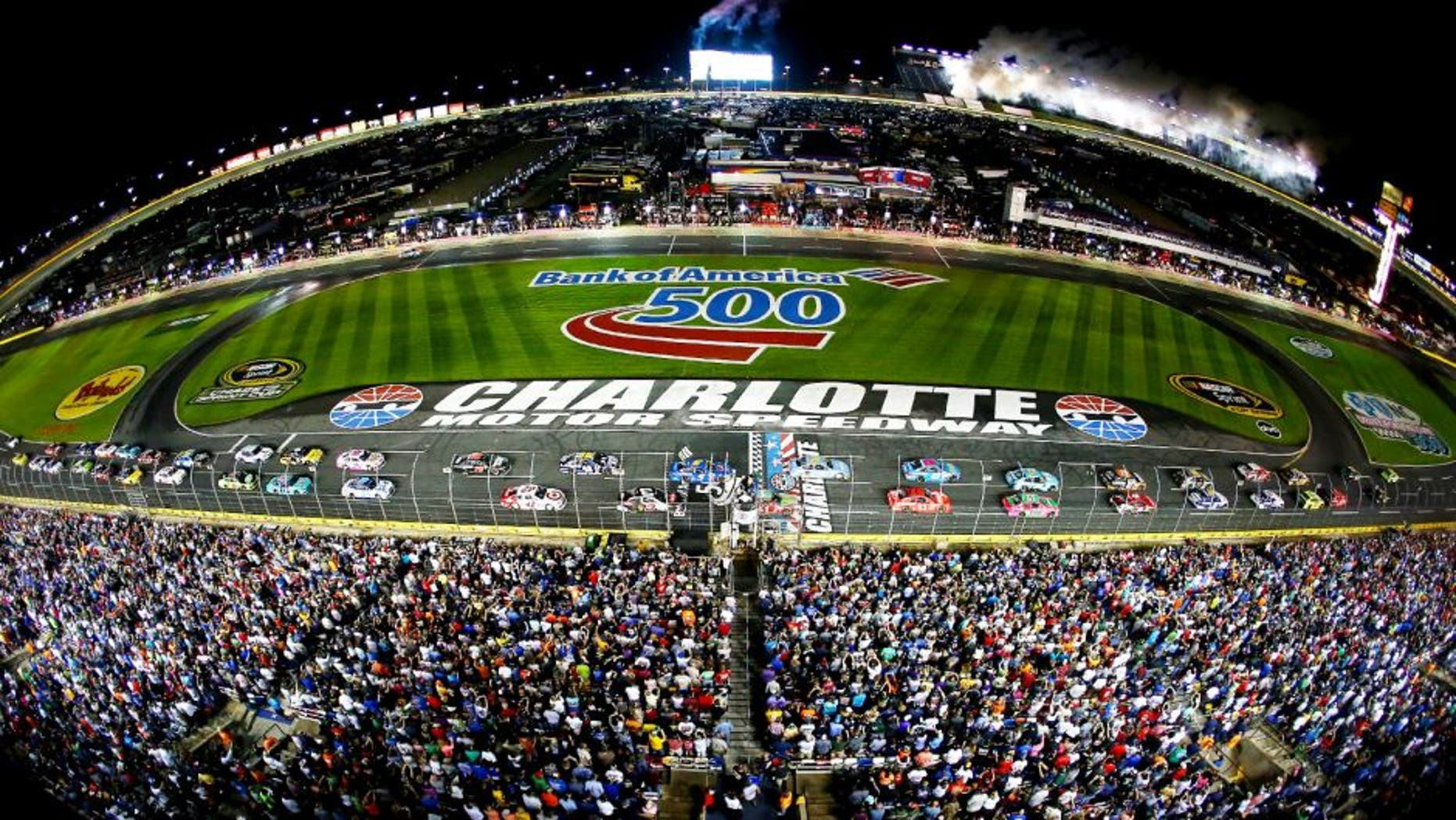 CHARLOTTE, NC - OCTOBER 11: Kyle Busch, driver of the #18 Doublemint Toyota, and Jeff Gordon, driver of the #24 Drive To End Hunger Chevrolet, lead the field to the green flag for the running of the NASCAR Sprint Cup Series Bank of America 500 at Charlotte Motor Speedway on October 11, 2014 in Charlotte, North Carolina. (Photo by Streeter Lecka/Getty Images)