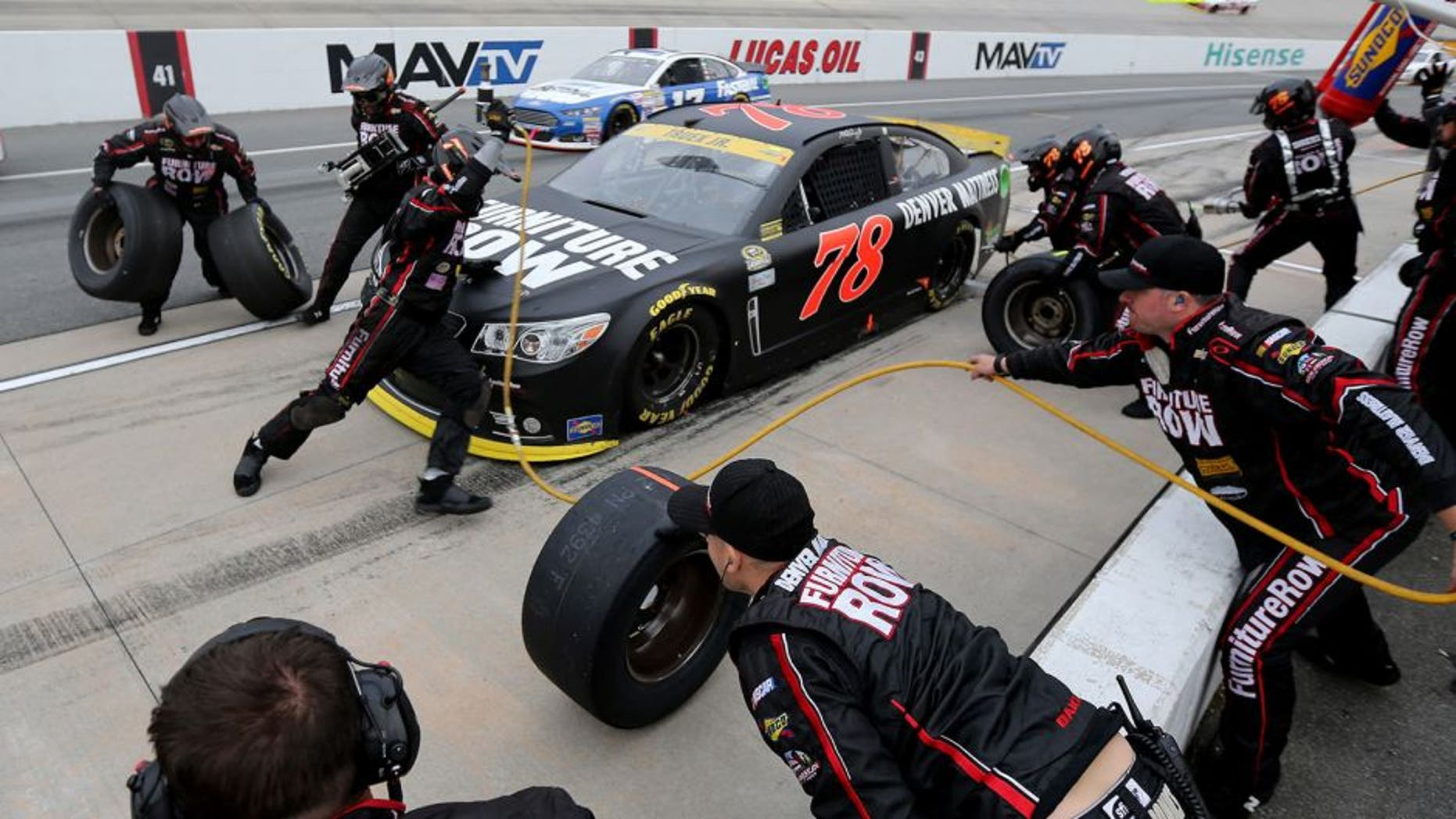 DOVER, DE - OCTOBER 04: Martin Truex Jr., driver of the #78 Furniture Row/Visser Precision Chevrolet, pits during the NASCAR Sprint Cup Series AAA 400 at Dover International Speedway on October 4, 2015 in Dover, Delaware. (Photo by Jerry Markland/Getty Images)
