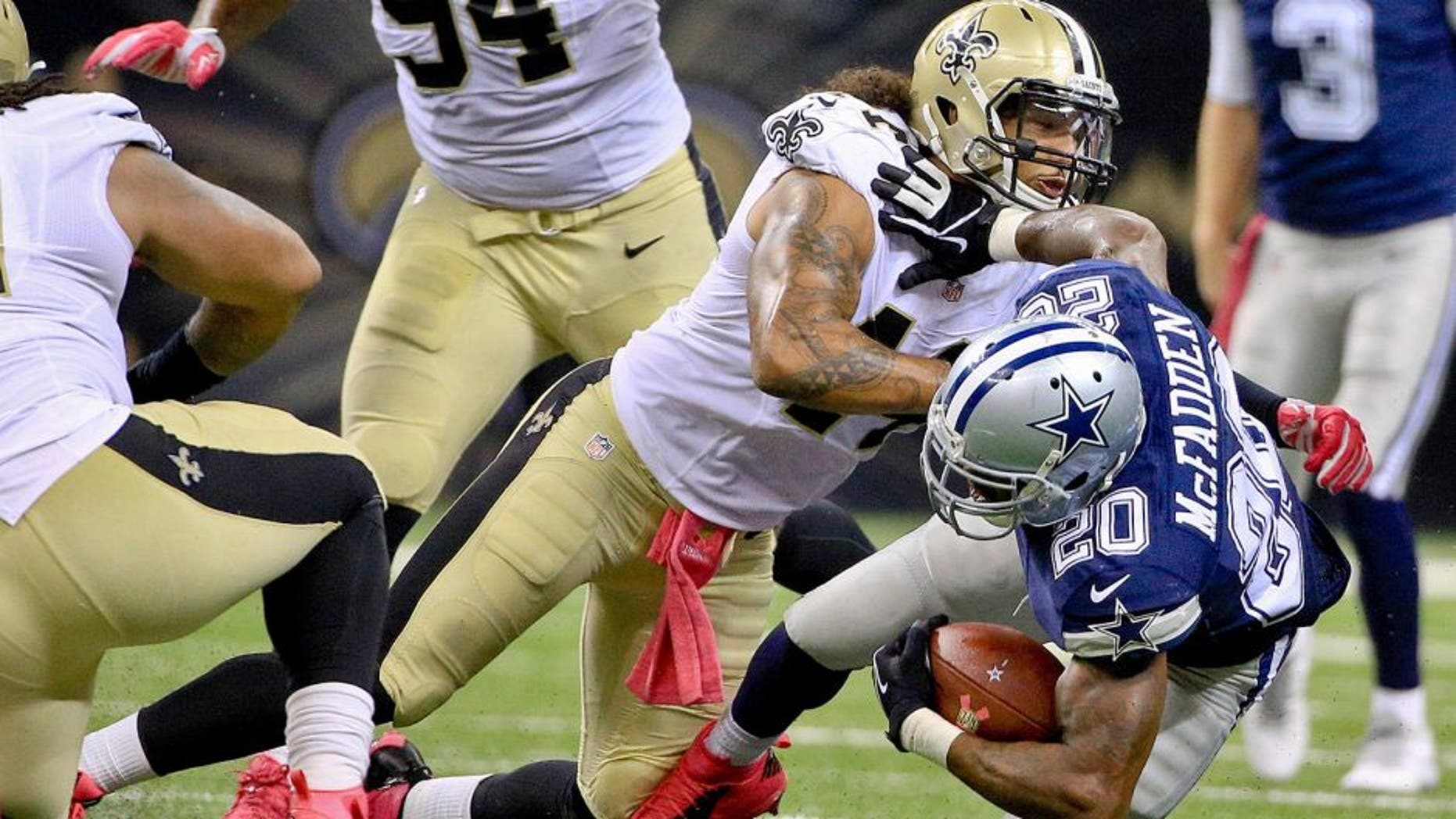 Oct 4, 2015; New Orleans, LA, USA; New Orleans Saints outside linebacker Hau'oli Kikaha (44) tackles Dallas Cowboys running back Darren McFadden (20) during the second half at the Mercedes-Benz Superdome. The Saints won 26-20 in overtime. Mandatory Credit: Derick E. Hingle-USA TODAY Sports