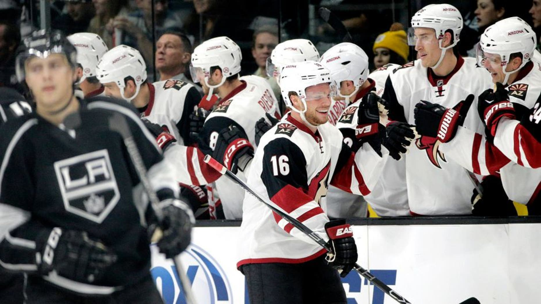 Arizona Coyotes' Max Domi, center, celebrates his goal with teammates during the second period of an NHL hockey game against the Los Angeles Kings, Friday, Oct. 9, 2015, in Los Angeles. (AP Photo/Jae C. Hong)