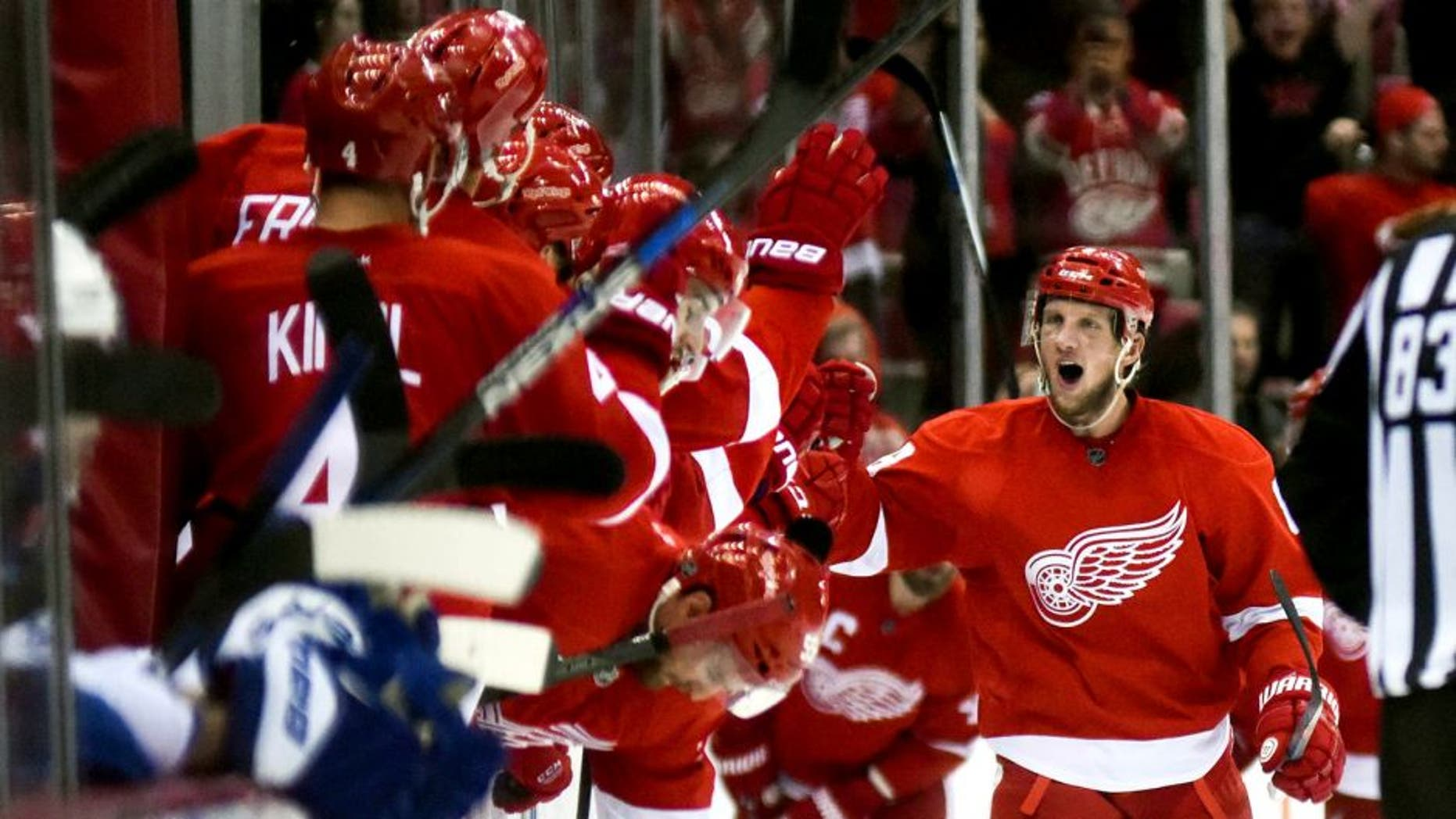 Oct 9, 2015; Detroit, MI, USA; Detroit Red Wings left wing Justin Abdelkader (8) celebrates his goal and hat trick during the second period against the Toronto Maple Leafs at Joe Louis Arena. Mandatory Credit: Tim Fuller-USA TODAY Sports