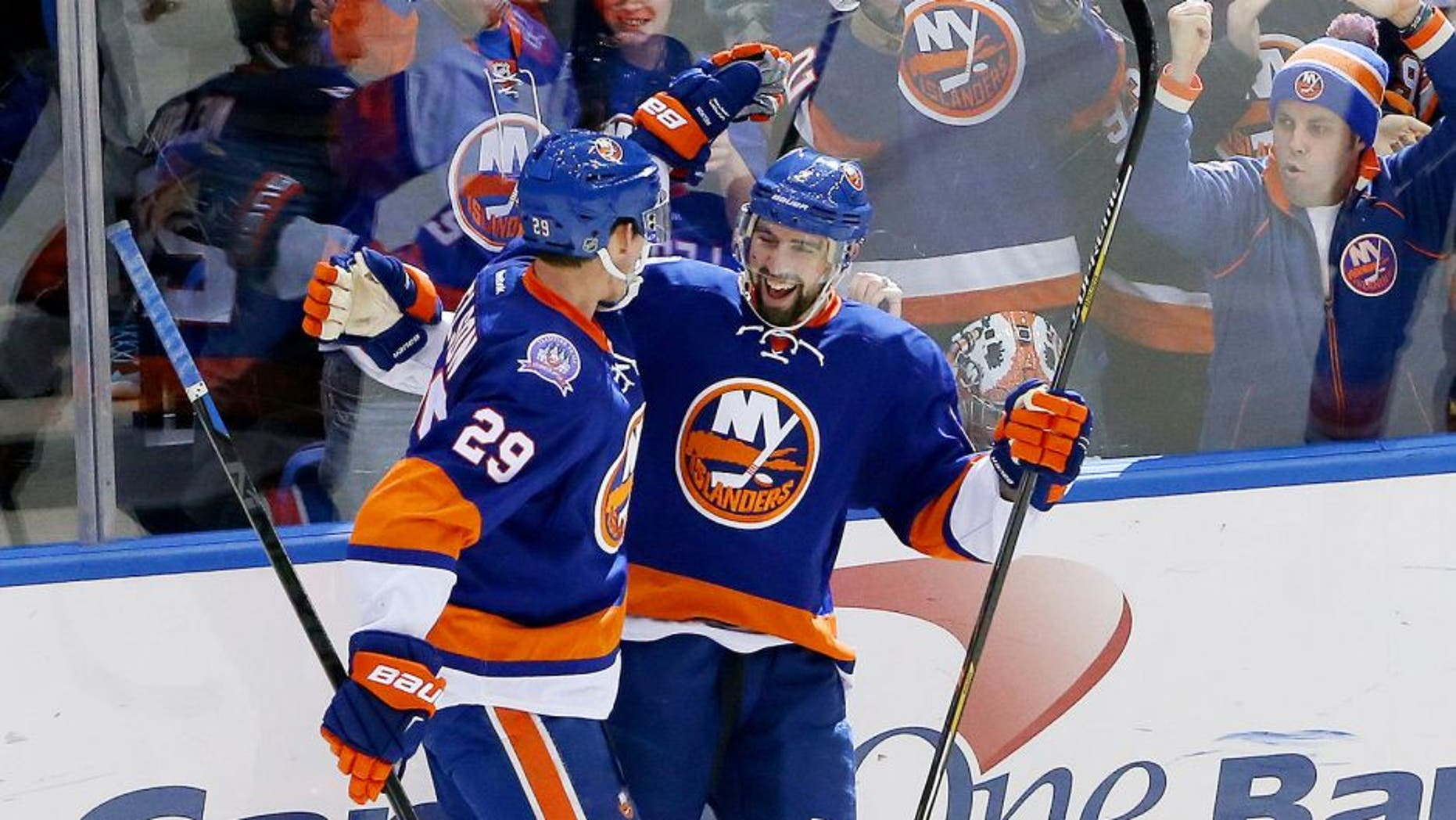 Feb 19, 2015; Uniondale, NY, USA; New York Islanders defenseman Nick Leddy (2) celebrates his goal with center Brock Nelson (29) during the third period against the Nashville Predators at Nassau Veterans Memorial Coliseum. New York Islanders won 5-2. Mandatory Credit: Anthony Gruppuso-USA TODAY Sports