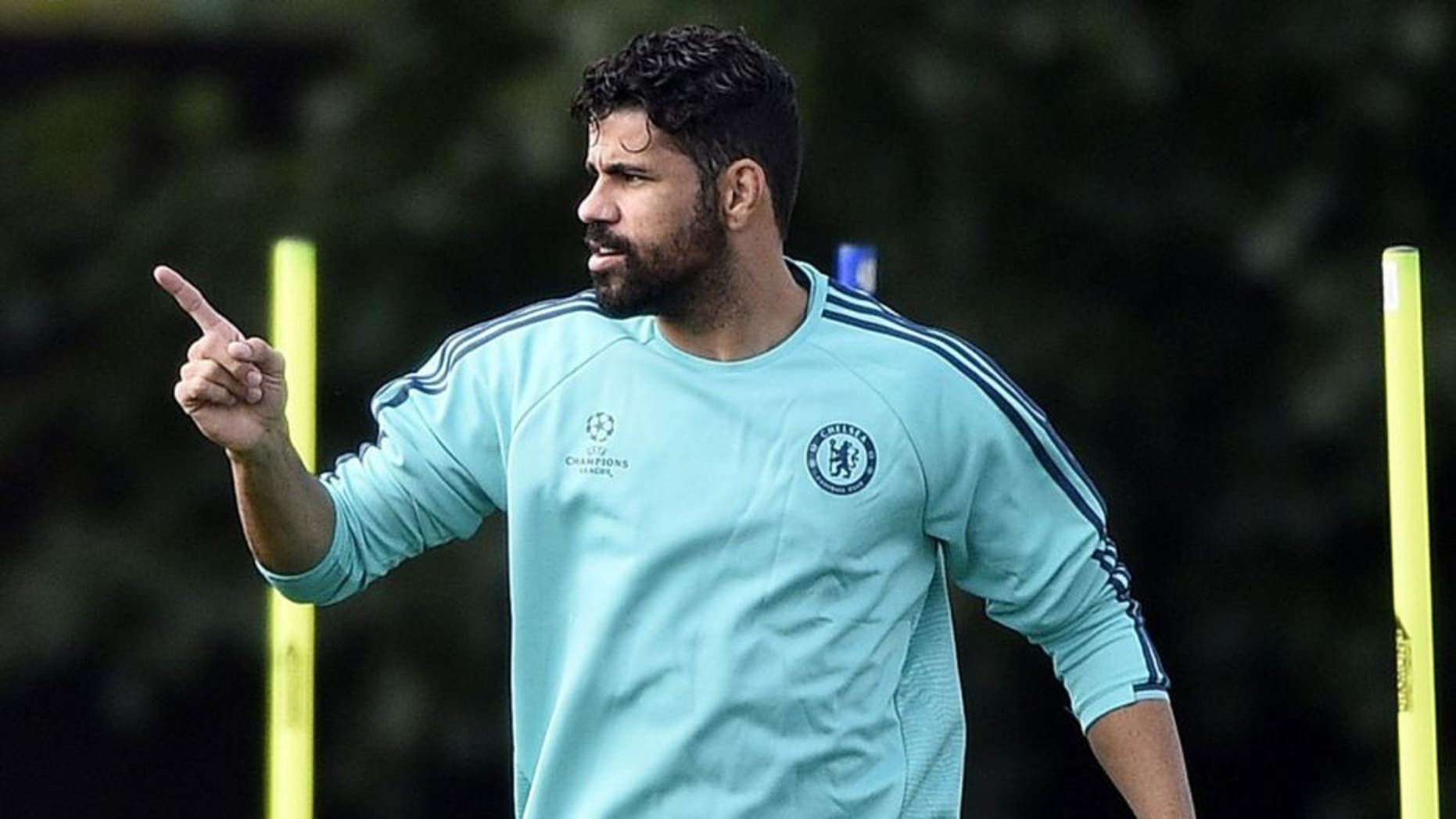 Chelsea's Brazilian-born Spanish striker Diego Costa reacts during a training session at Chelsea's training ground in Stoke D'Abernon, south of London, on September 28, 2015, on the eve of their UEFA Champions League Group G football match against Porto. AFP PHOTO / FRANCK FIFE (Photo credit should read FRANCK FIFE/AFP/Getty Images)