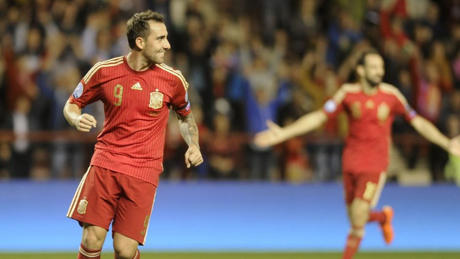 Spain's forward Paco Alcacer (L) celebrates after scoring during the Euro 2016 qualifying football match Spain vs Luxembourg at Las Gaunas stadium in Logrono on October 9, 2015. AFP PHOTO/ ANDER GILLENEA (Photo credit should read ANDER GILLENEA/AFP/Getty Images)
