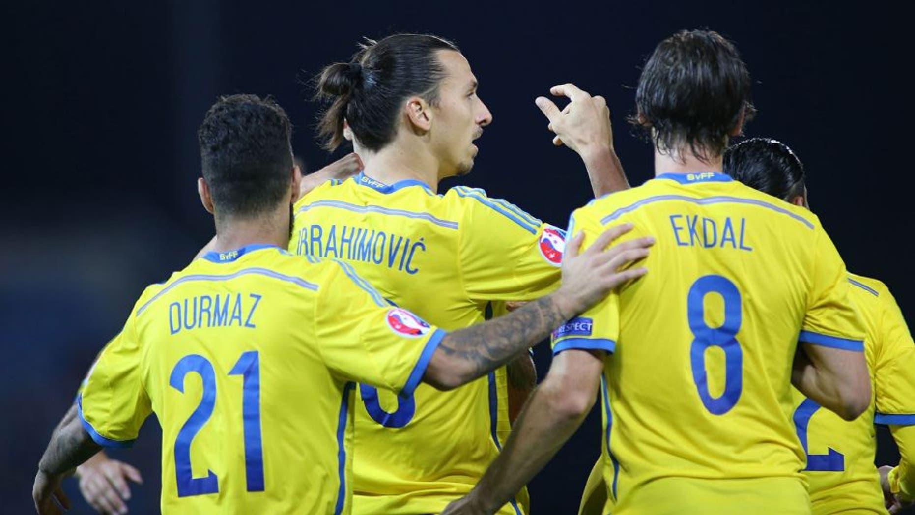 Swedens Zlatan Ibrahimovic (2nd L) celebrates with teammates Jimmy Durmaz (L) and Albin Ekdal after scoring his team's second goal during the Euro 2016 Group G qualifying football match between Liechtenstein and Sweden at the Rheinpark stadium in Vaduz on October 9, 2015. AFP PHOTO / MICHELE LIMINA (Photo credit should read MICHELE LIMINA/AFP/Getty Images)