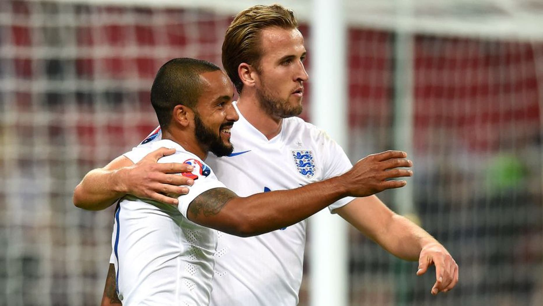 LONDON, ENGLAND - OCTOBER 09: Theo Walcott and Harry Kane of England celebrate after scoring the opening goal during the UEFA EURO 2016 Group E Qualifier match between England and Estonia at Wembley Stadium on October 9, 2015 in London, United Kingdom. (Photo by Michael Regan - The FA/The FA via Getty Images)
