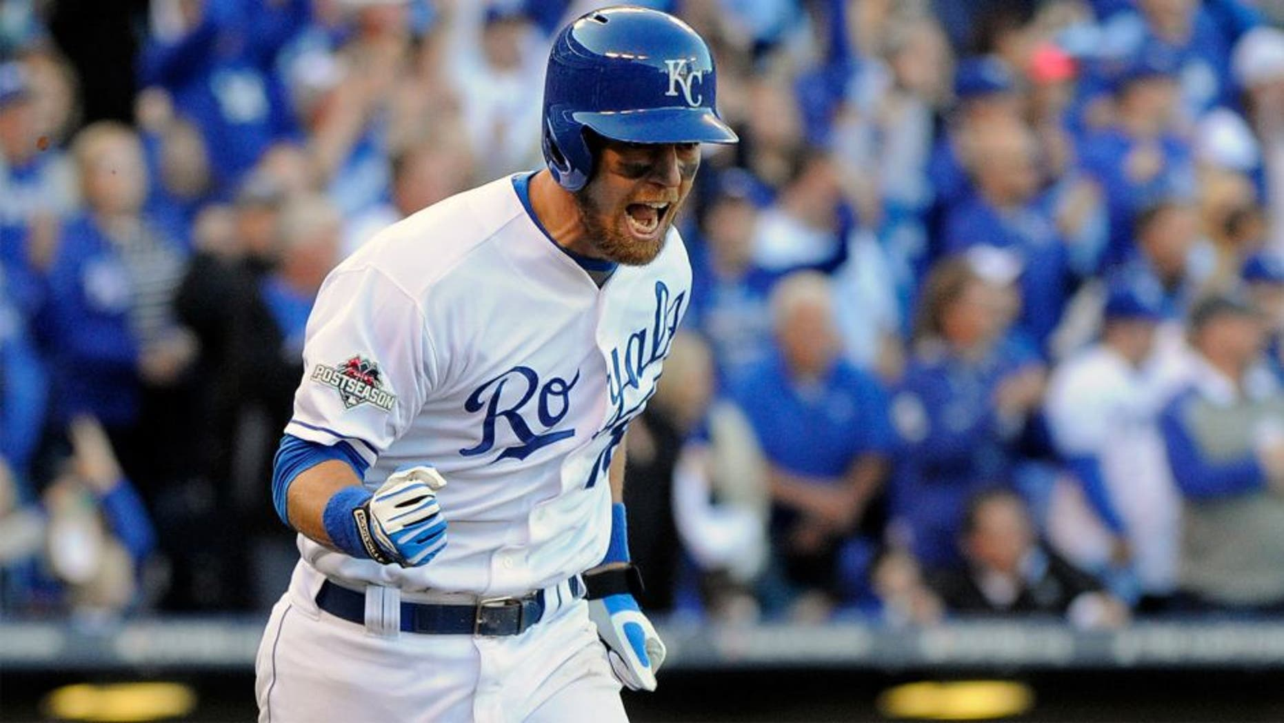 KANSAS CITY, MO - OCTOBER 09: Ben Zobrist #18 of the Kansas City Royals celebrates hitting an RBI single in the seventh inning against Will Harris #36 of the Houston Astros to score Alcides Escobar #2 during game two of the American League Division Series at Kauffman Stadium on October 9, 2015 in Kansas City, Missouri. (Photo by Ed Zurga/Getty Images)
