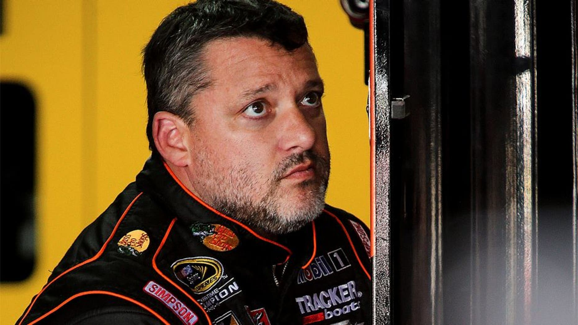 CHARLOTTE, NC - OCTOBER 08: Tony Stewart, driver of the #14 Bass Pro Shops/Mobil 1 Chevrolet, stis in the garage during practice for the NASCAR Sprint Cup Series Bank of America 500 at Charlotte Motor Speedway on October 8, 2015 in Charlotte, North Carolina. (Photo by Jerry Markland/Getty Images)