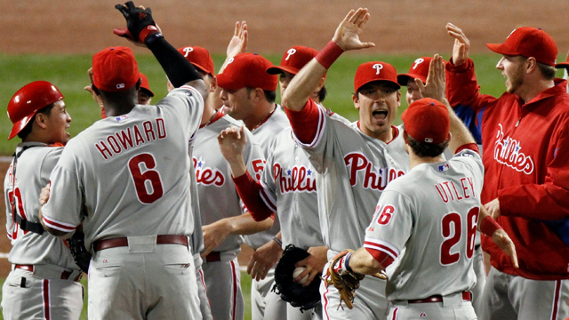 Oct. 10: The Philadelphia Phillies celebrate after beating the Cincinnati Reds 2-0 in Game 3 of baseball's National League Division Series in Cincinnati.