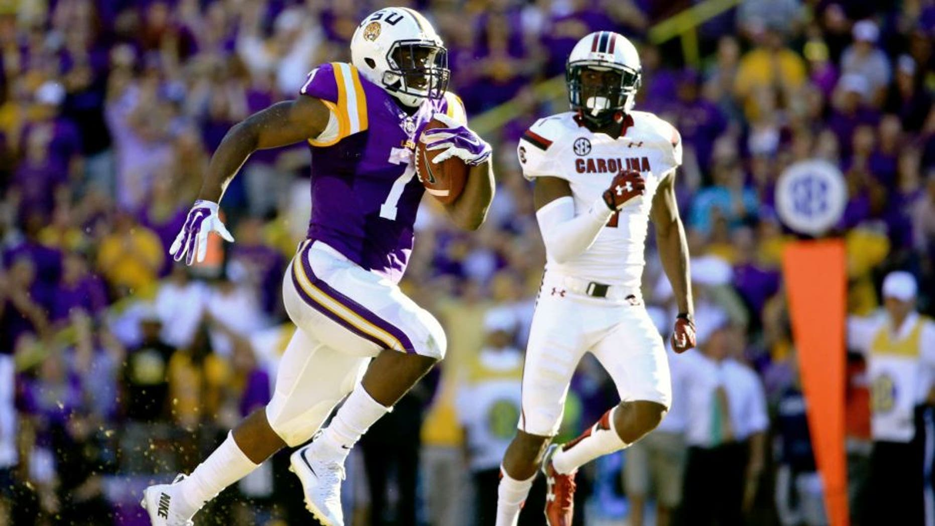 Oct 10, 2015; Baton Rouge, LA, USA; LSU Tigers running back Leonard Fournette (7) runs for an 87-yard touchdown during the third quarter of a game against the South Carolina Gamecocks at Tiger Stadium. Mandatory Credit: Derick E. Hingle-USA TODAY Sports
