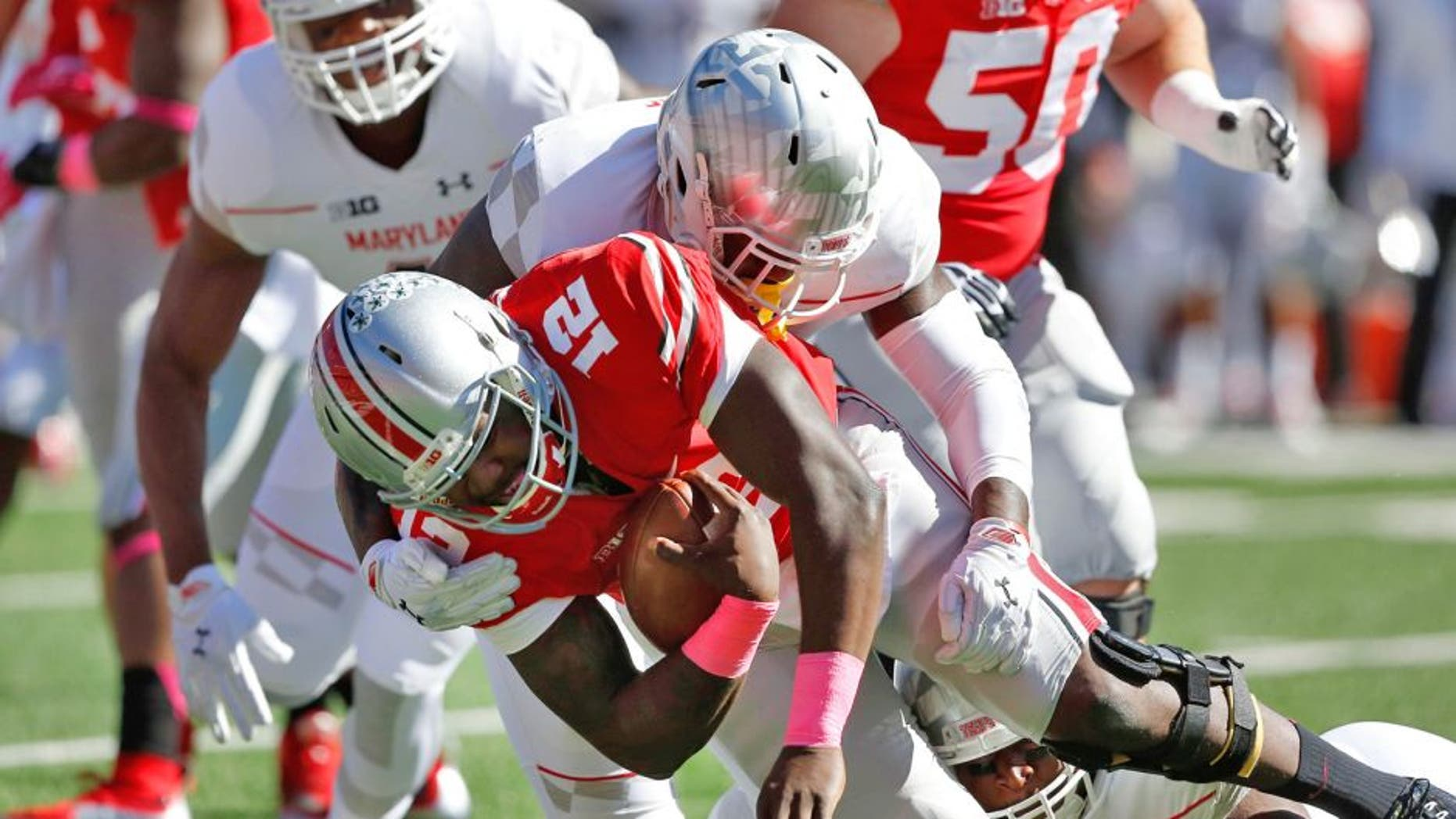Oct 10, 2015; Columbus, OH, USA; Ohio State Buckeyes quarterback Cardale Jones (12) is sacked by Maryland Terrapins defensive lineman Yannick Ngakoue (7) during the first quarter at Ohio Stadium. Mandatory Credit: Joe Maiorana-USA TODAY Sports
