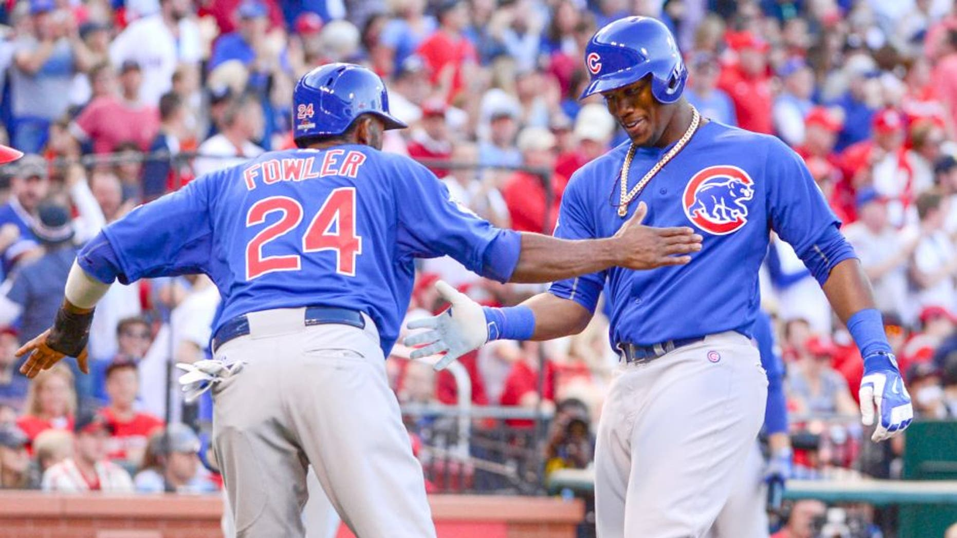 Oct 10, 2015; St. Louis, MO, USA; Chicago Cubs right fielder Jorge Soler (right) is congratulated by center fielder Dexter Fowler (24) for both scoring on a two-run home run by Soler against the St. Louis Cardinals during the second inning in game two of the NLDS at Busch Stadium. Mandatory Credit: Jeff Curry-USA TODAY Sports