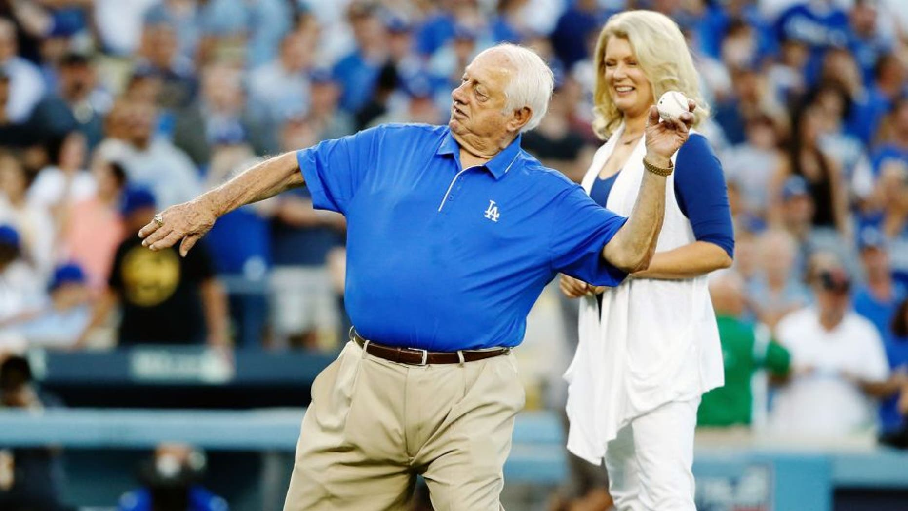 LOS ANGELES, CA - OCTOBER 10: Los Angeles Dodgers legend Tommy Lasorda throws out the ceremonial first pitch before the Dodgers take on the New York Mets in game two of the National League Division Series at Dodger Stadium on October 10, 2015 in Los Angeles, California. (Photo by Sean M. Haffey/Getty Images)