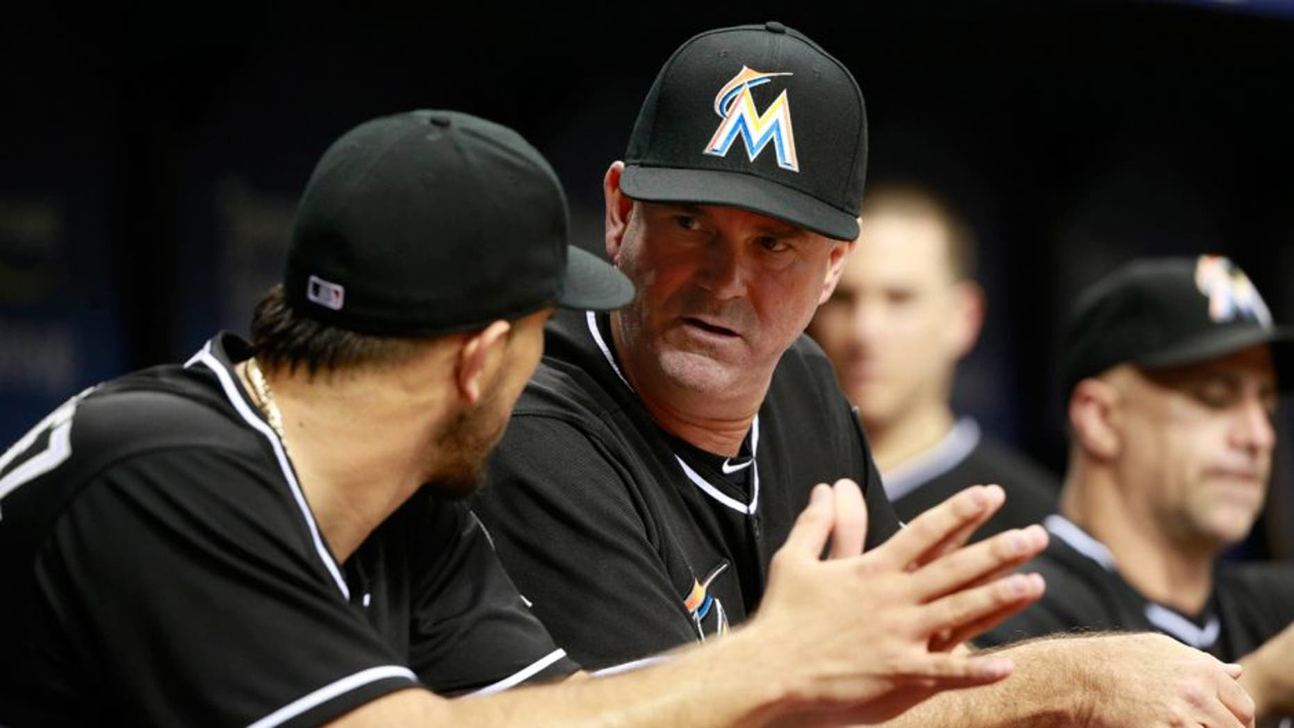 Oct 1, 2015; St. Petersburg, FL, USA; Miami Marlins manager Dan Jennings (26) talks with starting pitcher Jose Fernandez (16) during the fourth inning against the Tampa Bay Rays at Tropicana Field. Mandatory Credit: Kim Klement-USA TODAY Sports