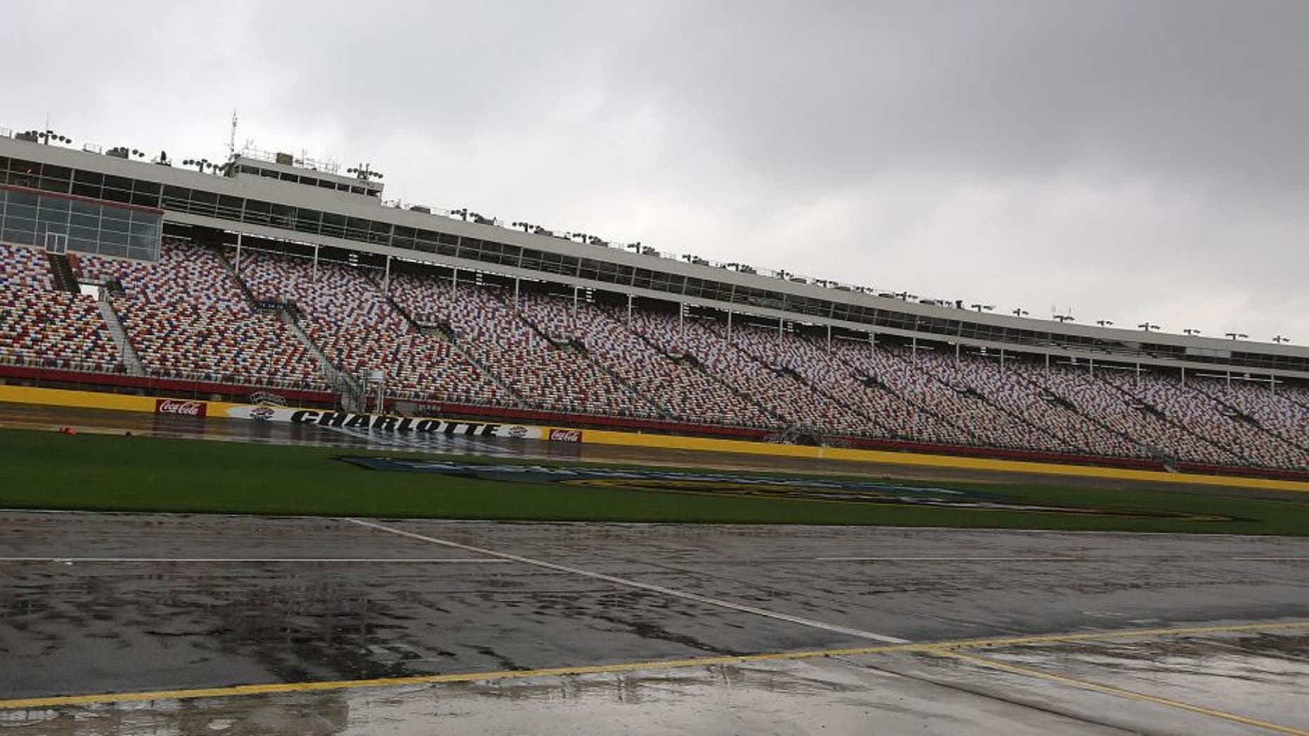 CHARLOTTE, NC - MAY 15: Rain falls on the speedway prior to practice being cancelled for the NASCAR Camping World Truck Series NC Education Lottery 200 at Charlotte Motor Speedway on May 15, 2014 in Charlotte, North Carolina. (Photo by Jerry Markland/Getty Images)