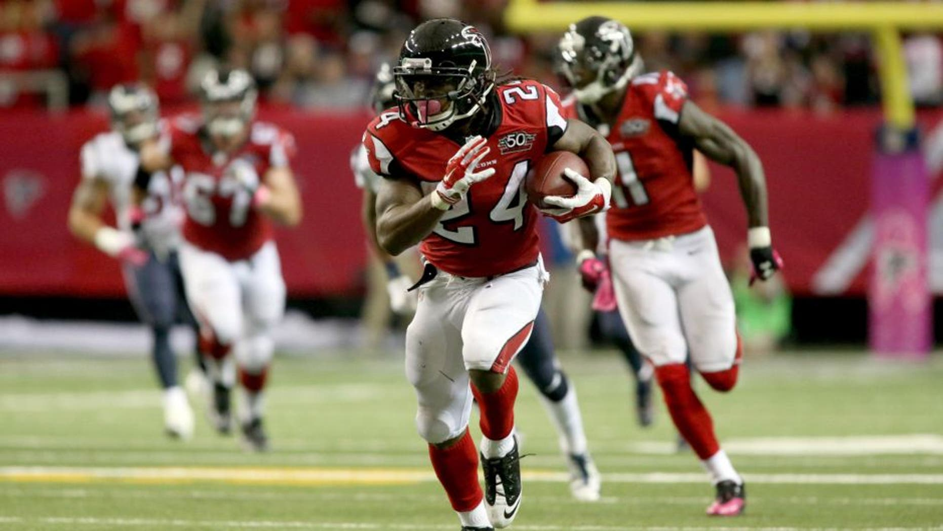 Oct 4, 2015; Atlanta, GA, USA; Atlanta Falcons running back Devonta Freeman (24) runs after a catch in the second quarter of their game against the Houston Texans at the Georgia Dome. The Falcons won 48-21. Mandatory Credit: Jason Getz-USA TODAY Sports