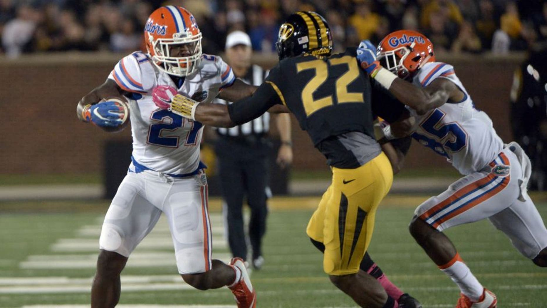 Oct 10, 2015; Columbia, MO, USA; Florida Gators running back Kelvin Taylor (21) runs the ball as Missouri Tigers defensive back Anthony Sherrils (22) defends during the first half at Faurot Field. Mandatory Credit: Denny Medley-USA TODAY Sports