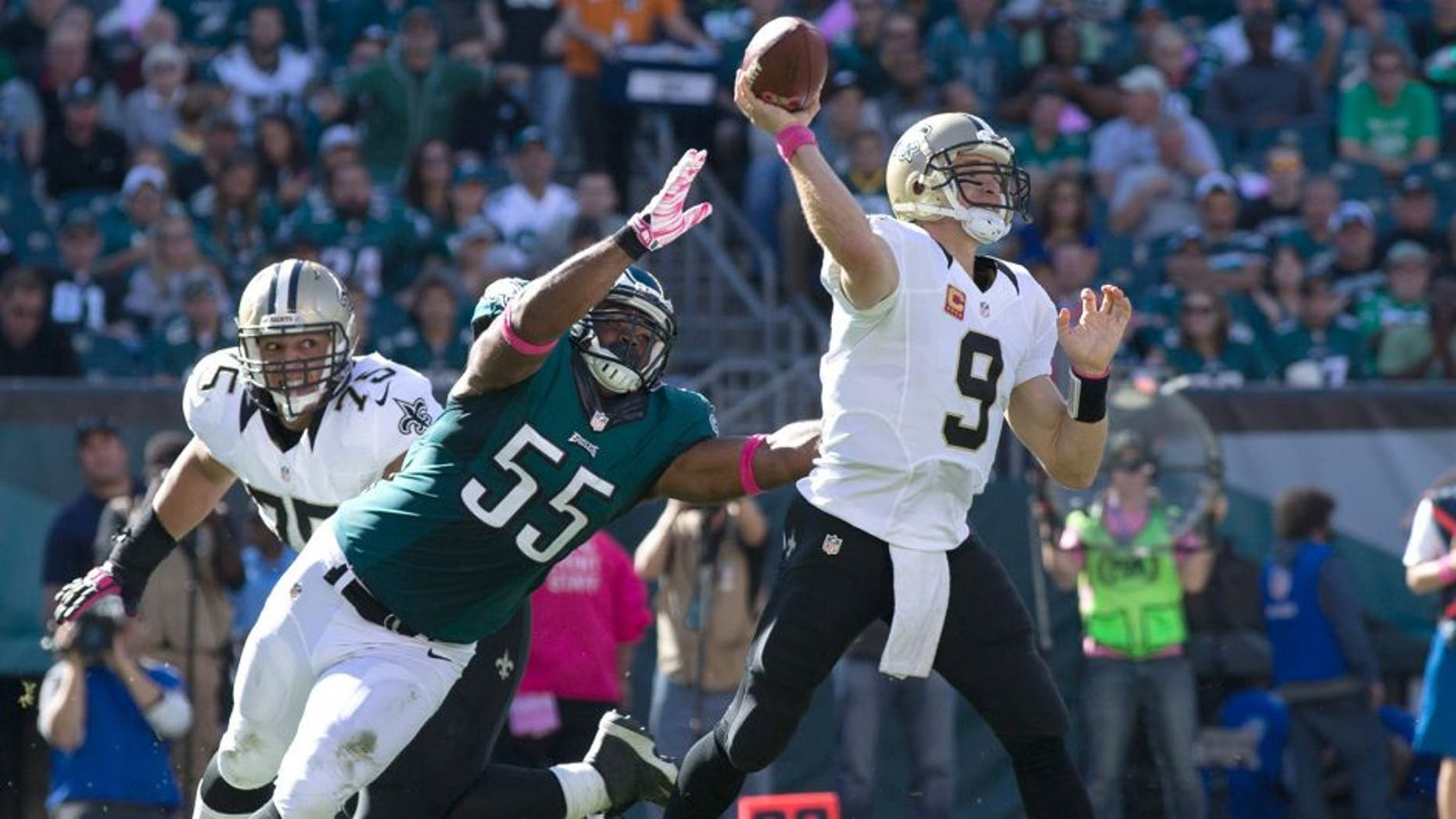 Oct 11, 2015; Philadelphia, PA, USA; New Orleans Saints quarterback Drew Brees (9) passes against the defensive rush of Philadelphia Eagles outside linebacker Brandon Graham (55) during the third quarter at Lincoln Financial Field. Mandatory Credit: Bill Streicher-USA TODAY Sports