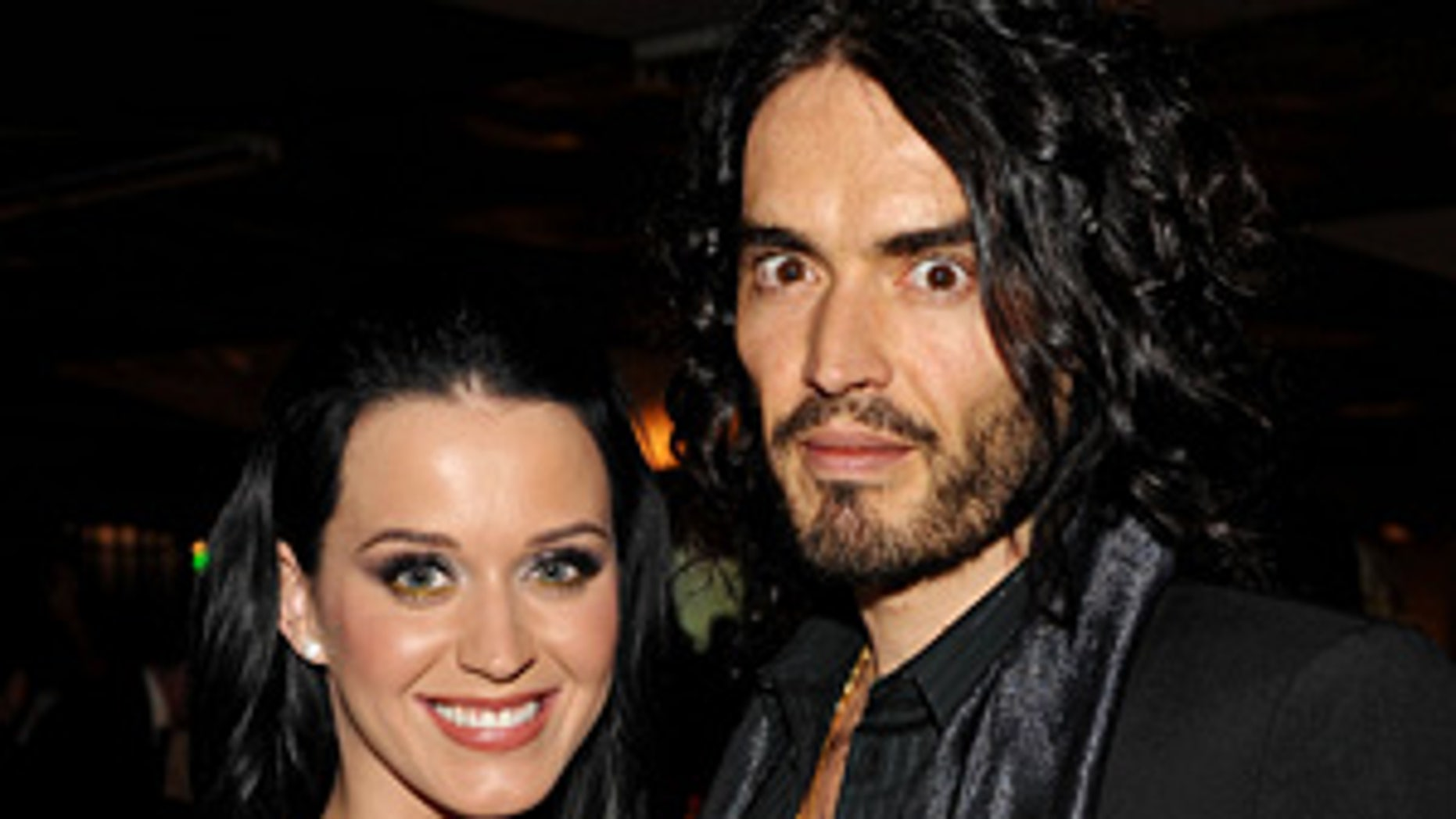 """BEVERLY HILLS, CA - JANUARY 16:  Singer Katy Perry and actor/comedian Russell Brand attend The Art of Elysium's 3rd Annual Black Tie Charity Gala """"Heaven"""" on January 16, 2010 in Beverly Hills, California.  (Photo by John Shearer/WireImage)"""