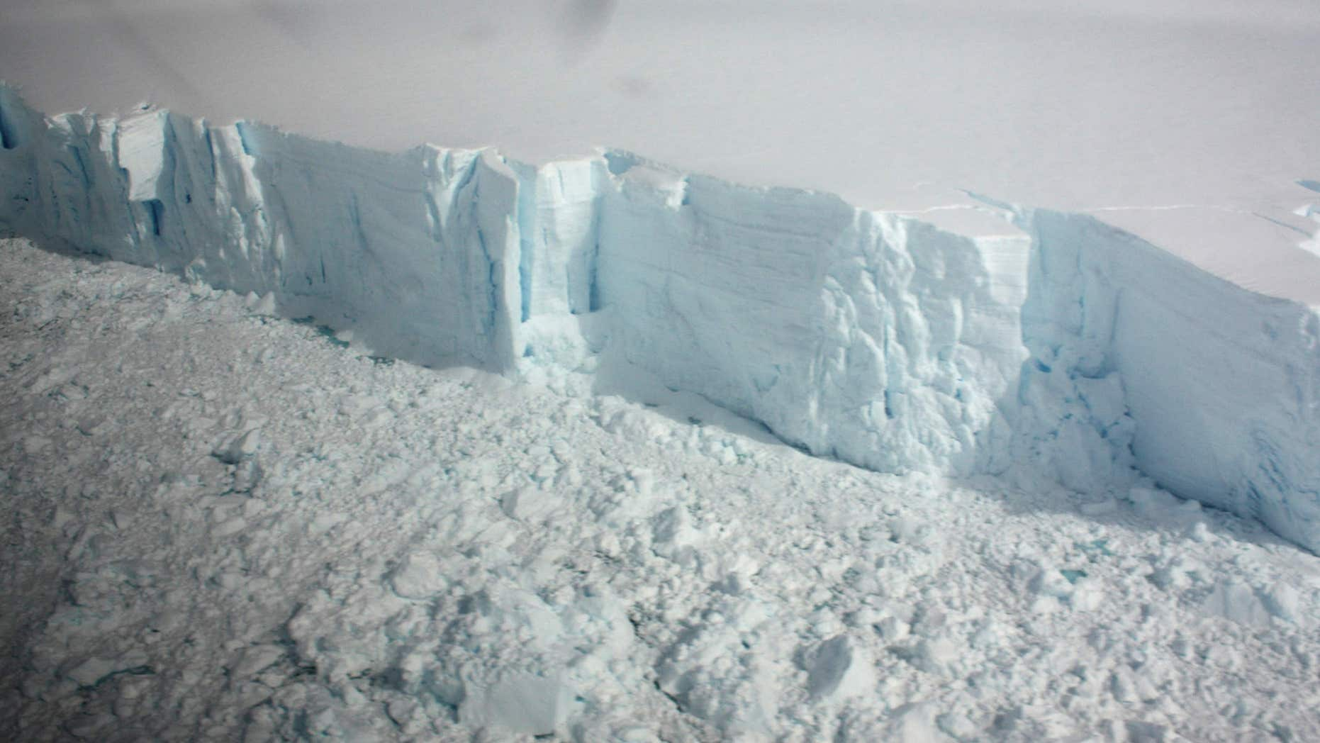 January 18, 2009: A 20 metre-high ice cliff forming the edge of the Wilkins Ice shelf on the Antarctic Peninsula is seen from a plane.