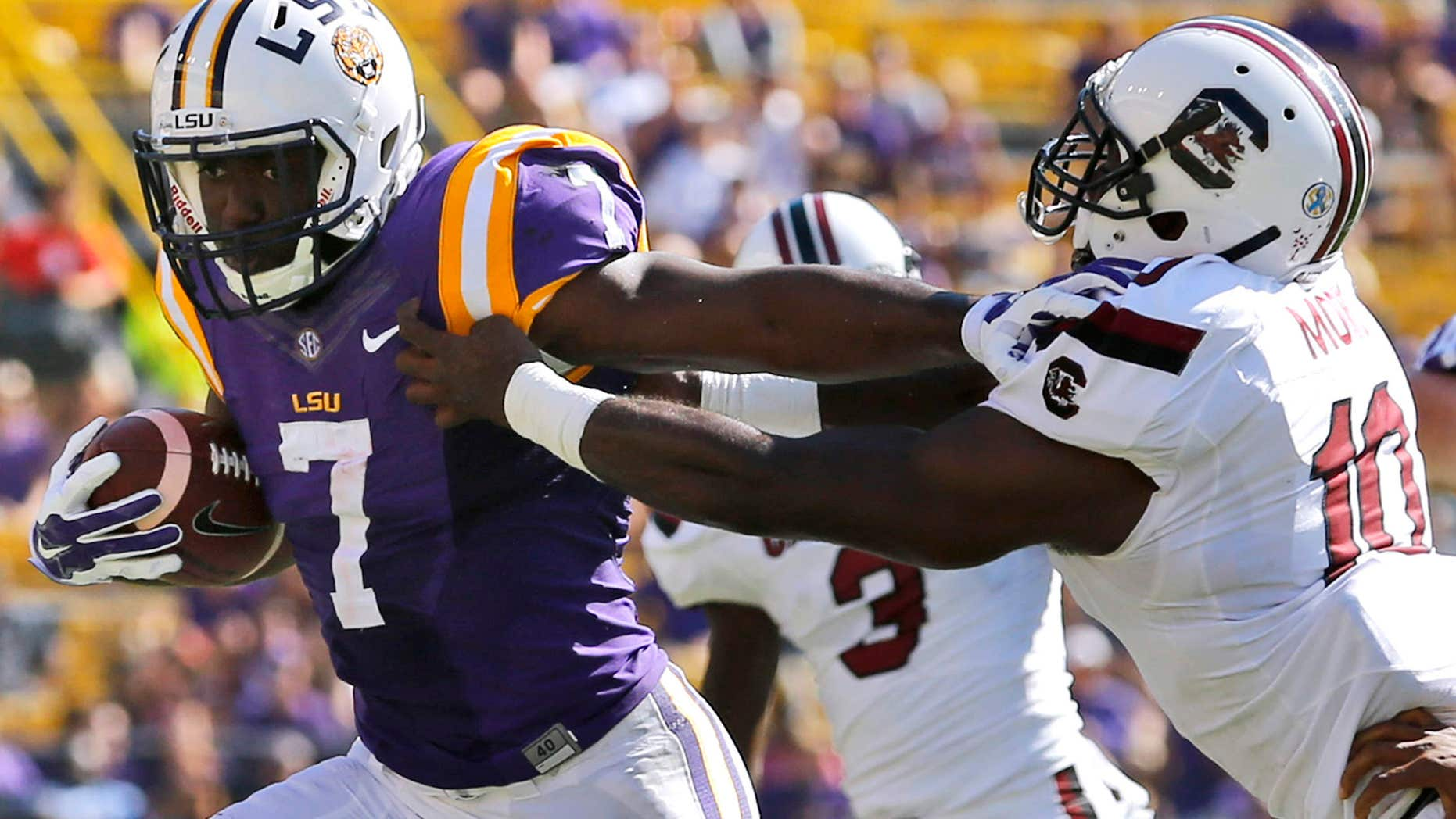 Oct. 10, 2015: LSU running back Leonard Fournette (7) stiff arms South Carolina linebacker Skai Moore (10) during the first half of an NCAA college football game in Baton Rouge, La.