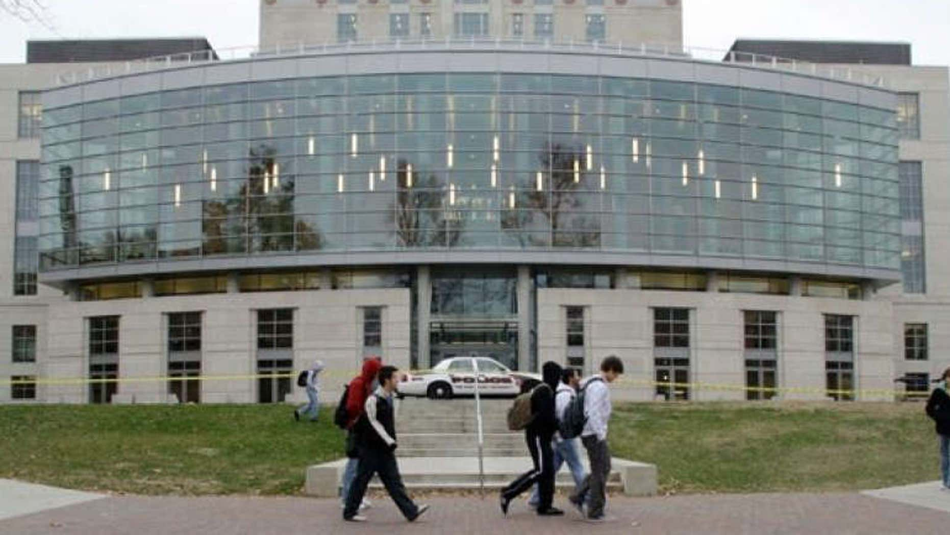 Nov. 16, 2010: Students walk past a closed library at Ohio State University in Columbus, Ohio. The school evacuated the main library, along with three other academic buildings, after the FBI received an e-mailed bomb threat targeting the university.