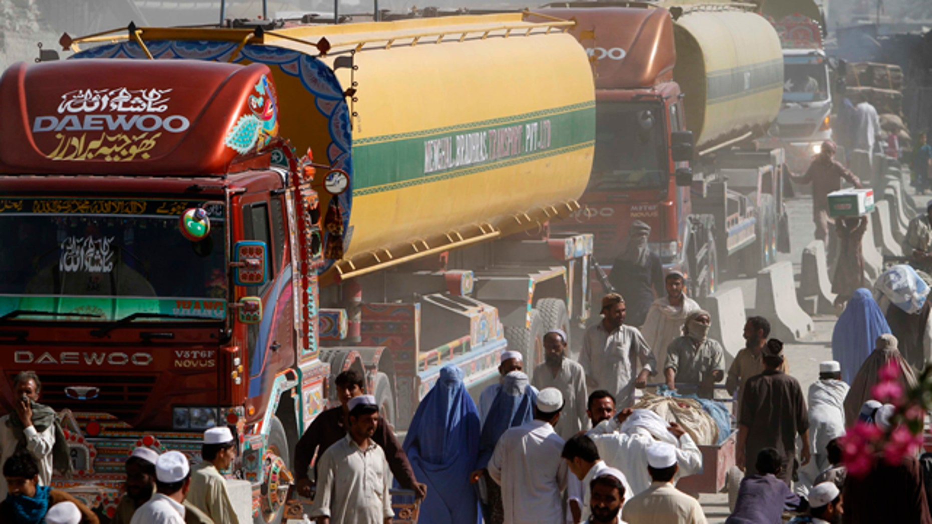 Oct. 10: NATO fuel tankers enter Afghanistan through Pakistan's border crossing in Torkham, east of Kabul.