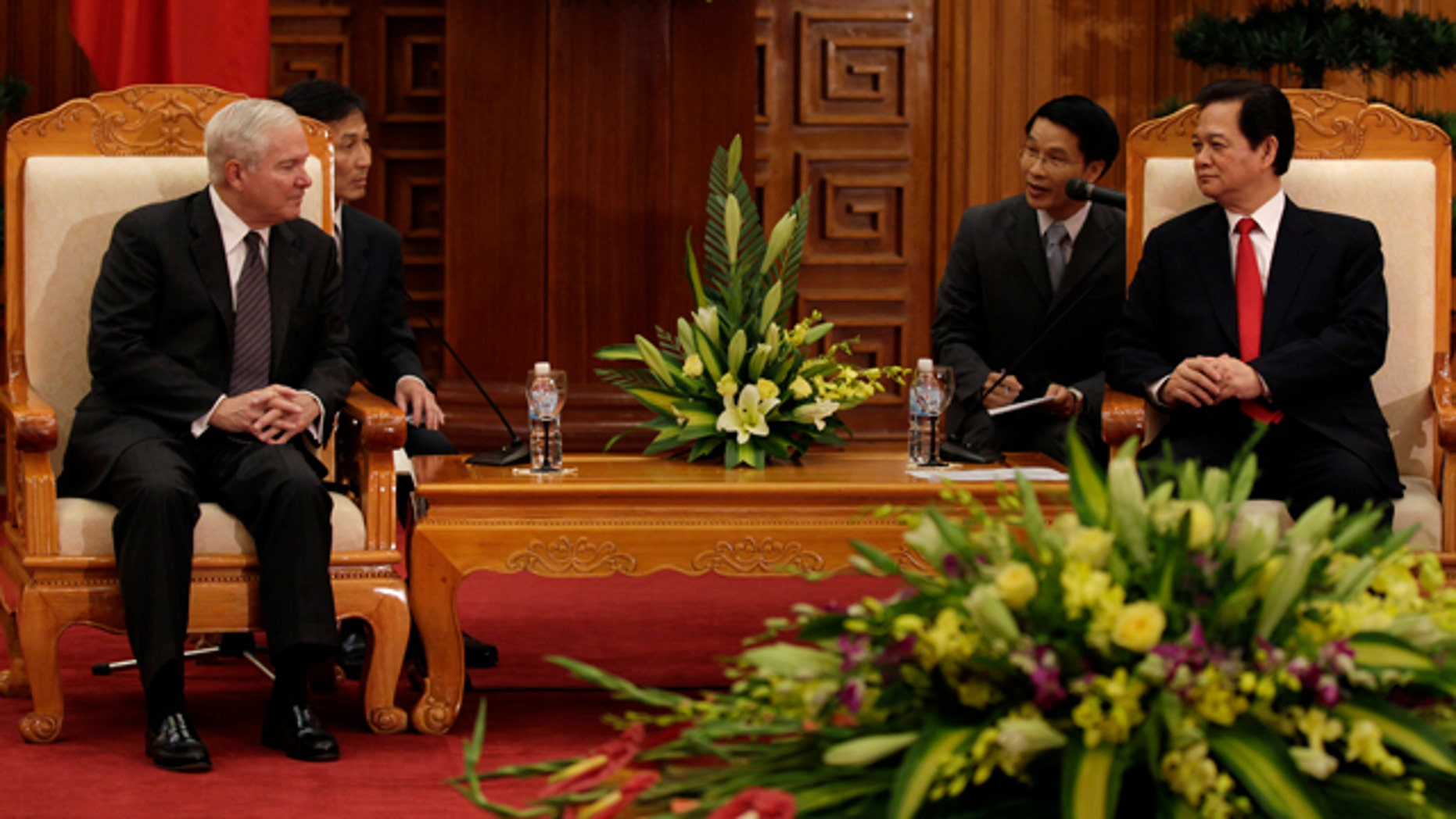 Oct. 11: Defense Secretary Robert Gates, left, meets with Vietnam's Prime Minister Nguyen Tan Dung in a meeting room at the Prime Minister's office in Hanoi, Vietnam.
