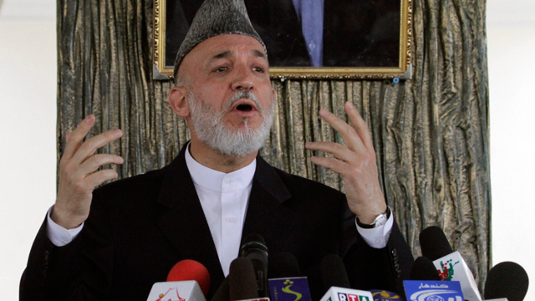 Oct. 11: Afghan President Hamid Karzai talks to Afghans in Argandab district of Kandahar province, south of Kabul, Afghanistan.