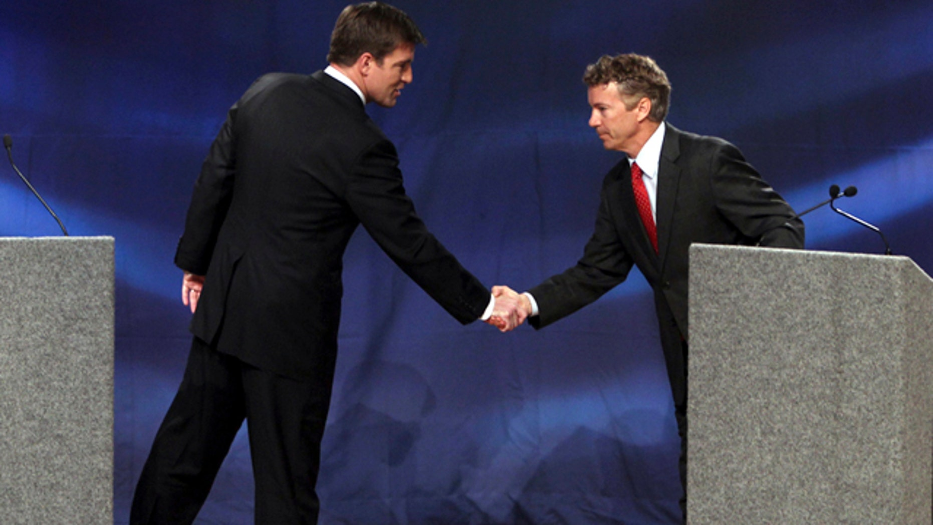 Oct. 11: Kentucky Senate candidates Democrat Jack Conway, left, and Republican Rand Paul, right, shake hands at the end of their debate at Northern Kentucky University in Highland Heights, Ky.