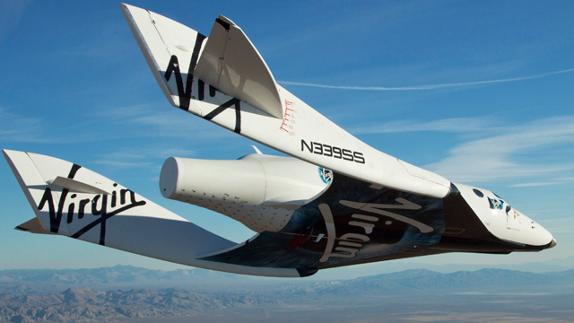 Oct. 10: In this photo released by Virgin Galactic, the Virgin Galactic SpaceShipTwo, or VSS Enterprise, glides toward the earth on its first test flight after release from the mothership, WhiteKnight2, also known as VMS Eve, over the Mojave, Calif., area.