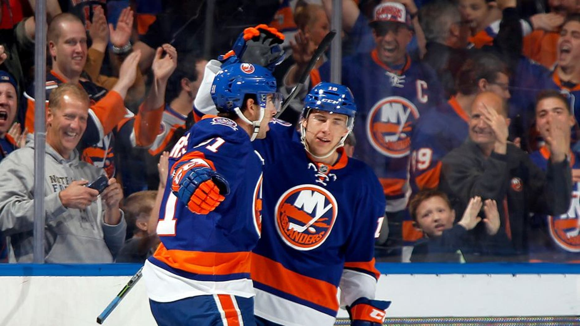 UNIONDALE, NY - OCTOBER 11: John Tavares #91 (L) and Ryan Strome #18 of the New York Islanders celebrate Tavares' first period goal against the Carolina Hurricanes at the Nassau Veterans Memorial Coliseum on October 11, 2014 in Uniondale, New York. (Photo by Bruce Bennett/Getty Images)