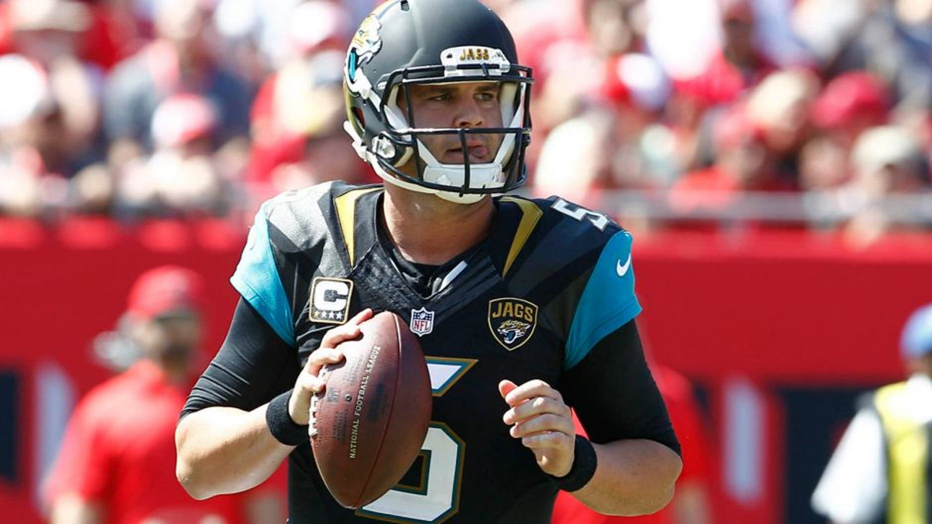 Oct 11, 2015; Tampa, FL, USA; Jacksonville Jaguars quarterback Blake Bortles (5) drops to throw a pass during the second quarter of an NFL football game against the Tampa Bay Buccaneers at Raymond James Stadium. Mandatory Credit: Reinhold Matay-USA TODAY Sports