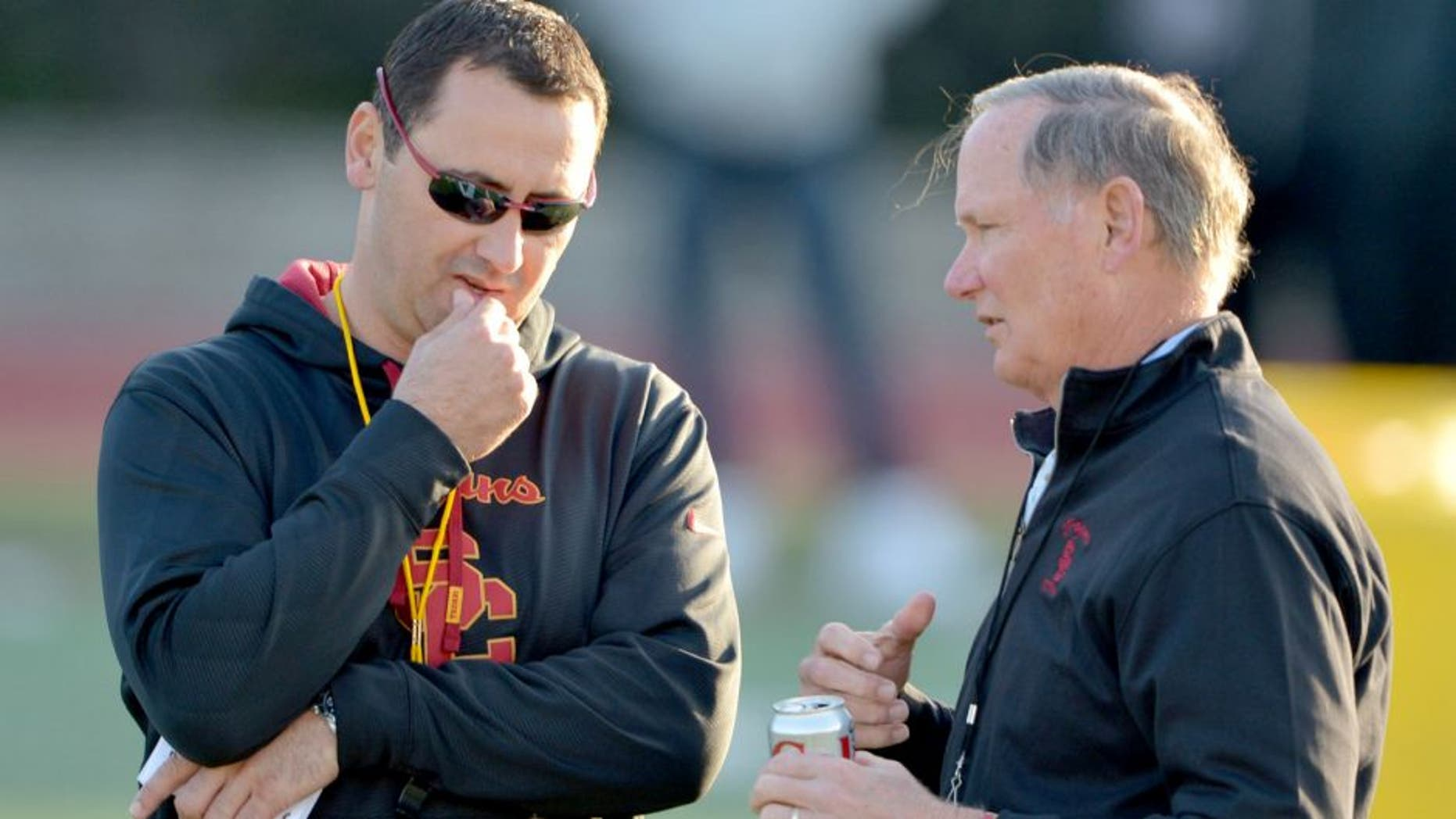 Mar 3, 2015; Los Angeles, CA, USA; Southern California Trojans coach Steve Sarkisian (left) and athletic director Pat Haden at spring practice at Cromwell Field. Mandatory Credit: Kirby Lee-USA TODAY Sports