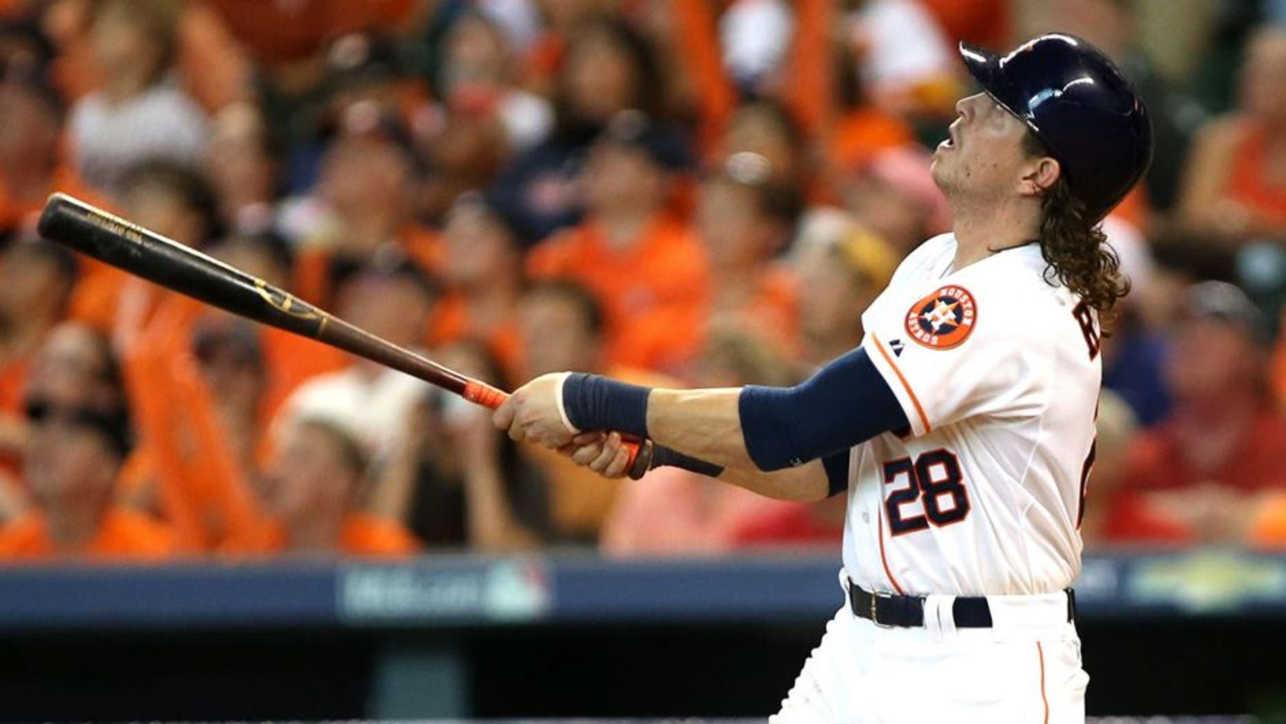 Oct 11, 2015; Houston, TX, USA; Houston Astros left fielder Colby Rasmus (28) hits a single off of the roof against the Kansas City Royals in game three of the ALDS at Minute Maid Park. Astros won 4-2. Mandatory Credit: Troy Taormina-USA TODAY Sports